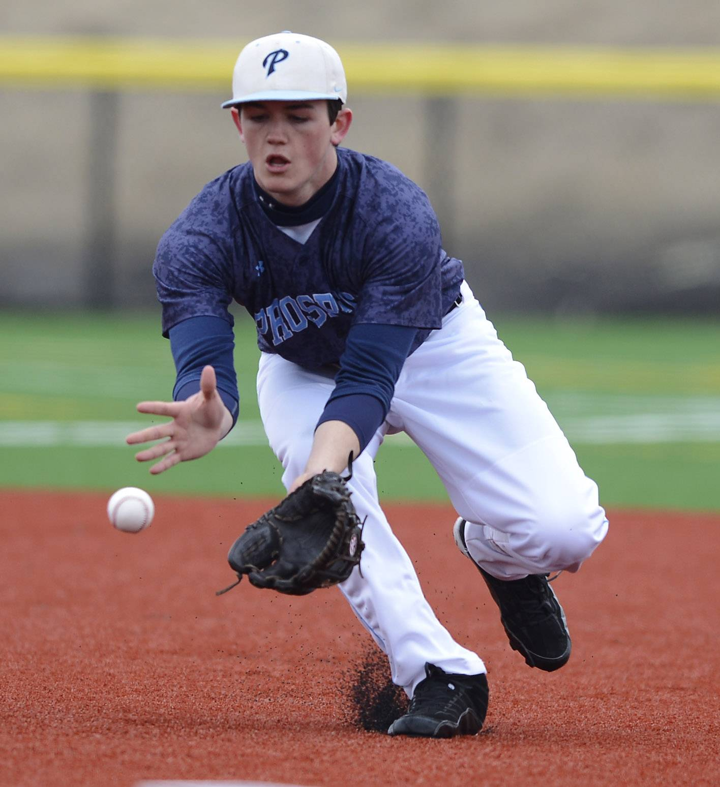 Prospect third baseman Patrick Donohue fields a groundball during Friday's game against Hinsdale Central at Heritage Park in Wheeling.