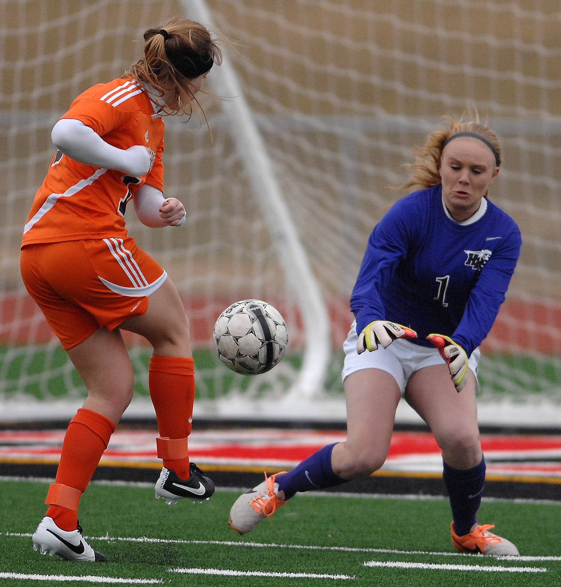 Huntley's Jessica Galason makes a point-blank save on a shot by Hersey's Lauren Gierman during Friday's game in Huntley.