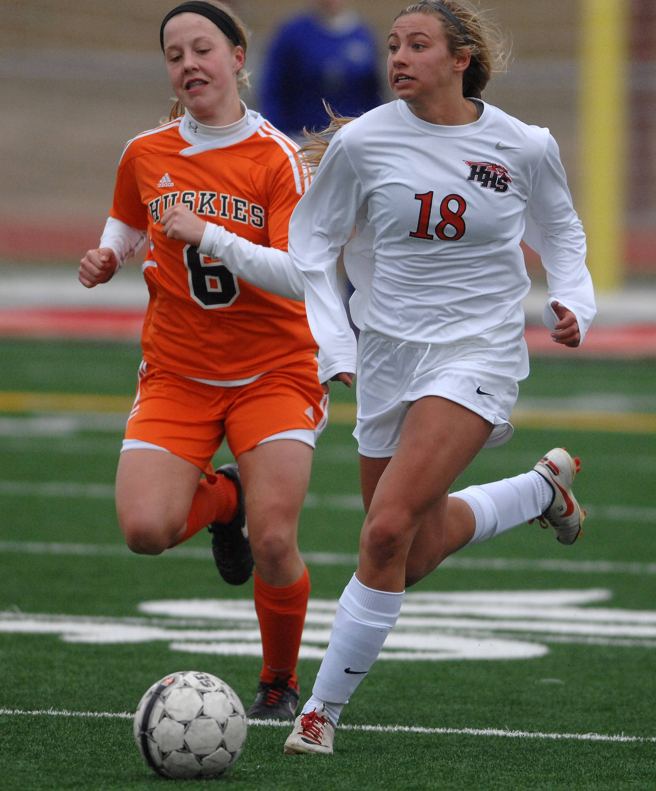 Huntley's Beth Parks races down field with Hersey's Sara Magnuson giving chase during Friday's game in Huntley.