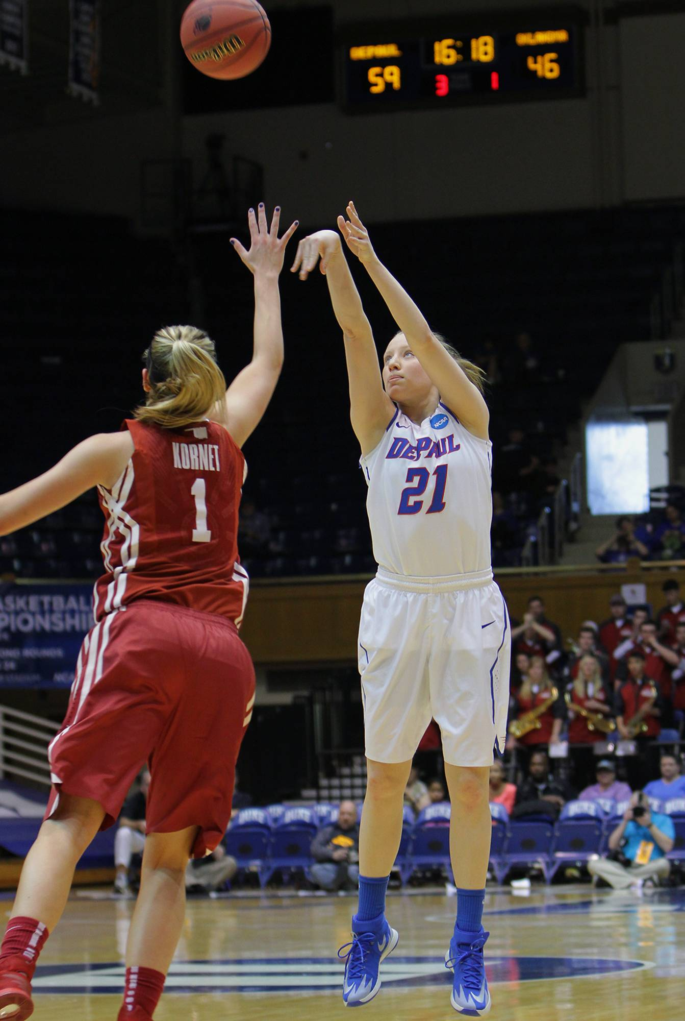 DePaul's Megan Rogowski, right, who scored a team-high 24 points, shoots a 3-pointer over Oklahoma's Nicole Kornet during the second half of a first-round game at the NCAA basketball tournament in Durham, N.C., Saturday, March 22, 2014.  DePaul won 104-100.