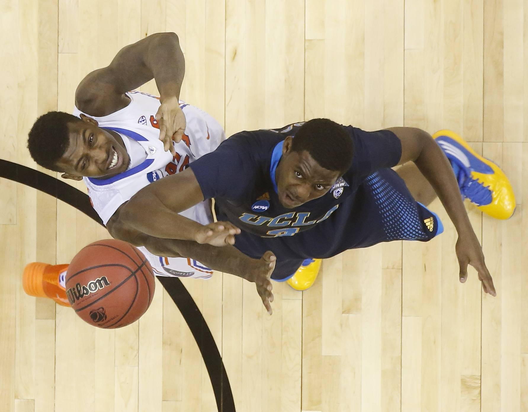 UCLA guard Jordan Adams (3) shoots against Florida forward Casey Prather (24) during the second half.