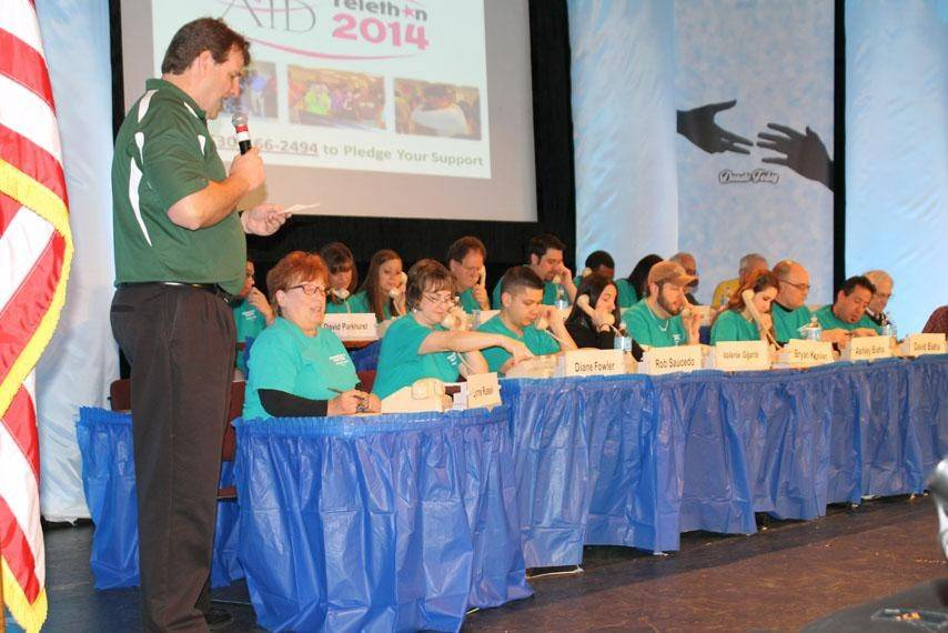Volunteers man the phones during the 15th annual AID Telethon at Waubonsee Community College in Sugar Grove.