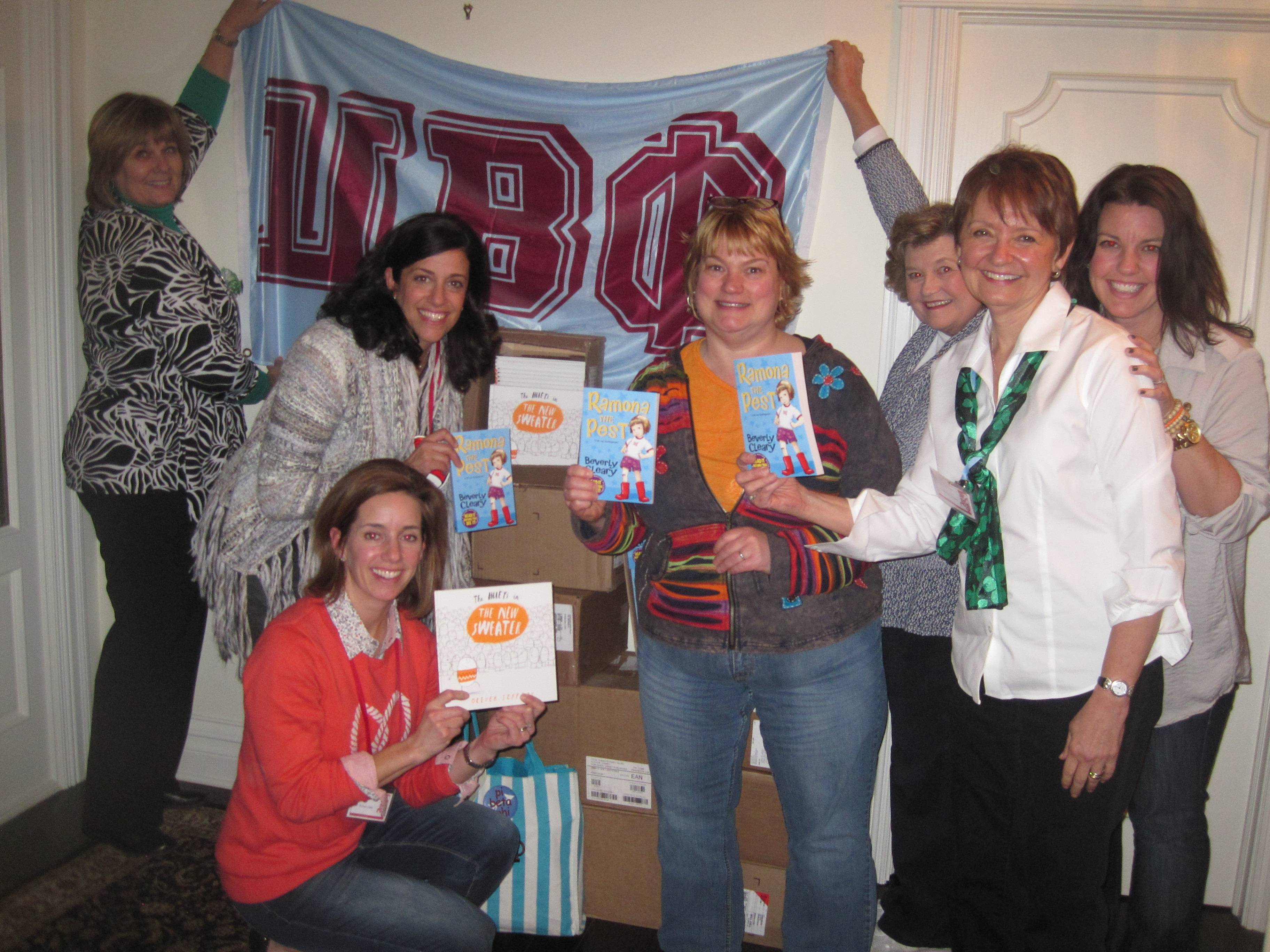 Members of the Glen Ellyn - Wheaton Alumnae Club of Pi Beta Phi show off a few of the 500 books donated to the Humanitarian Service Project.Anne Wanzenberg