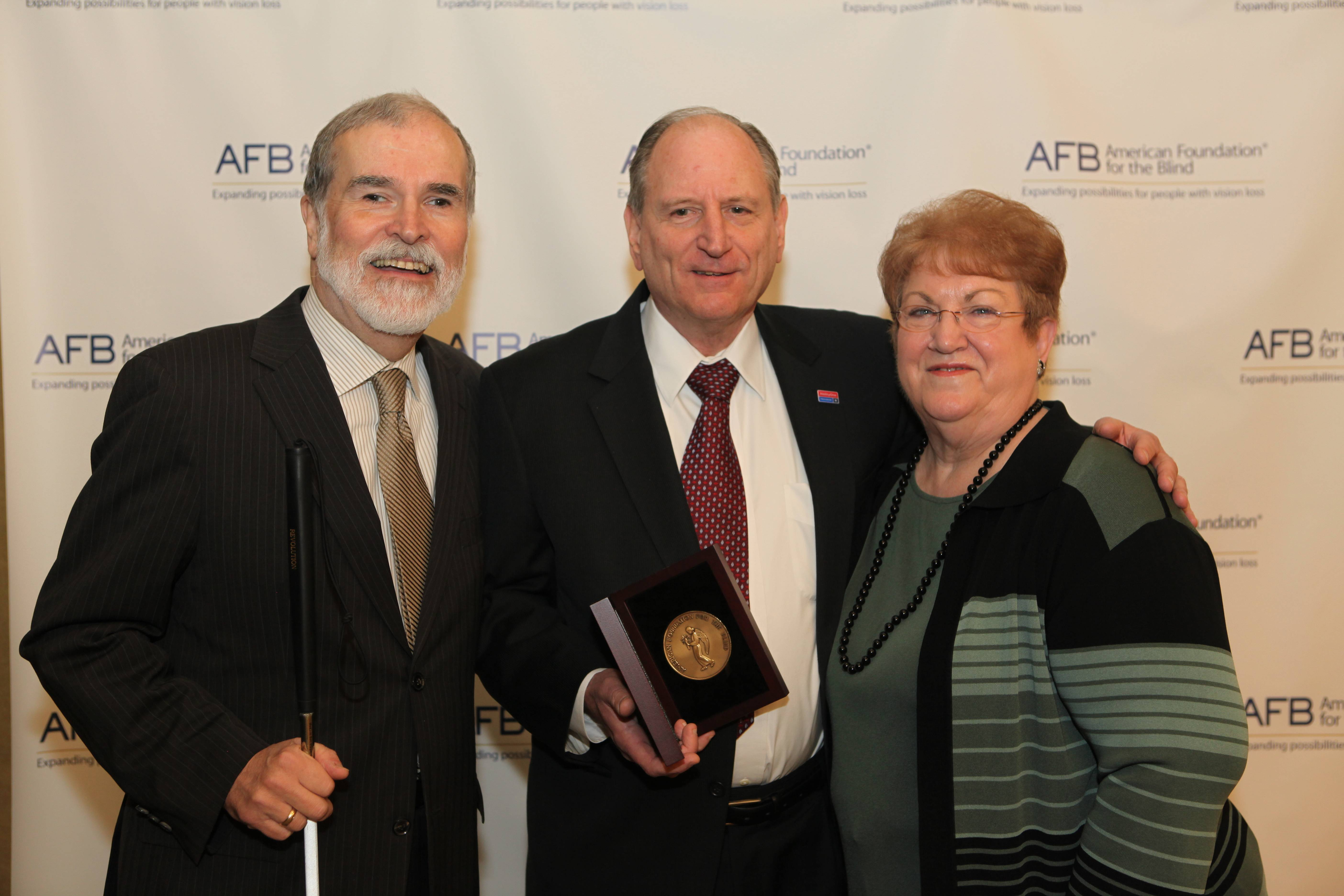 Arlington Heights resident James Kesteloot (center) poses with the prestigious Migel Award along with his wife, Barb, and Carl Augusto, president and CEO of the American Foundation for the Blind (AFB).(Photo courtesy of Seth Olenick for AFB)