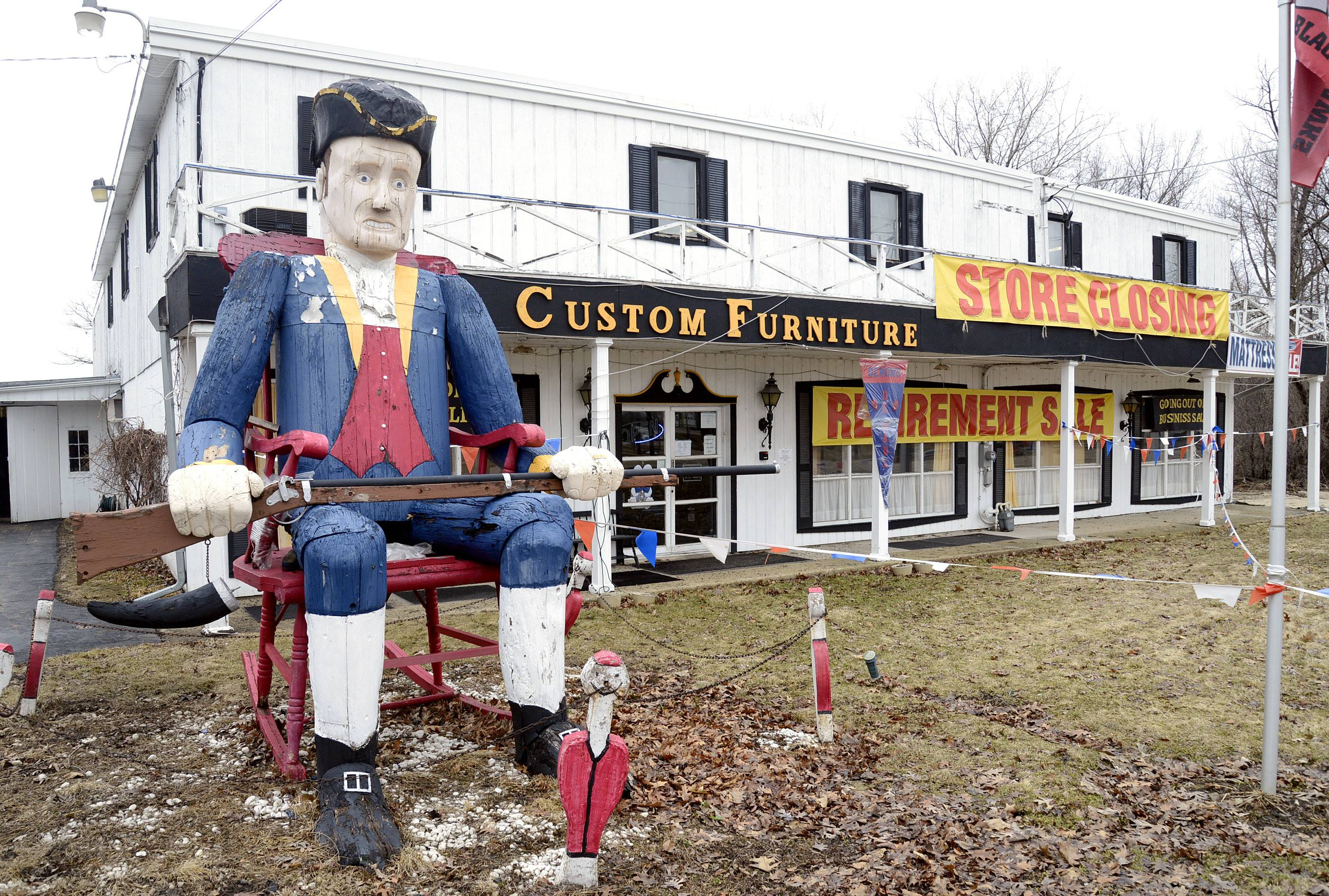 "Custom Furniture on Route 25 in St. Charles is closing because owner Dick Pakan is retiring. ""The Unknown Soldier,"" which sits out front, was made by his father with trees from the property in 1976. He is for sale if someone is interested. The head alone weighs 500 pounds, Pakan said."
