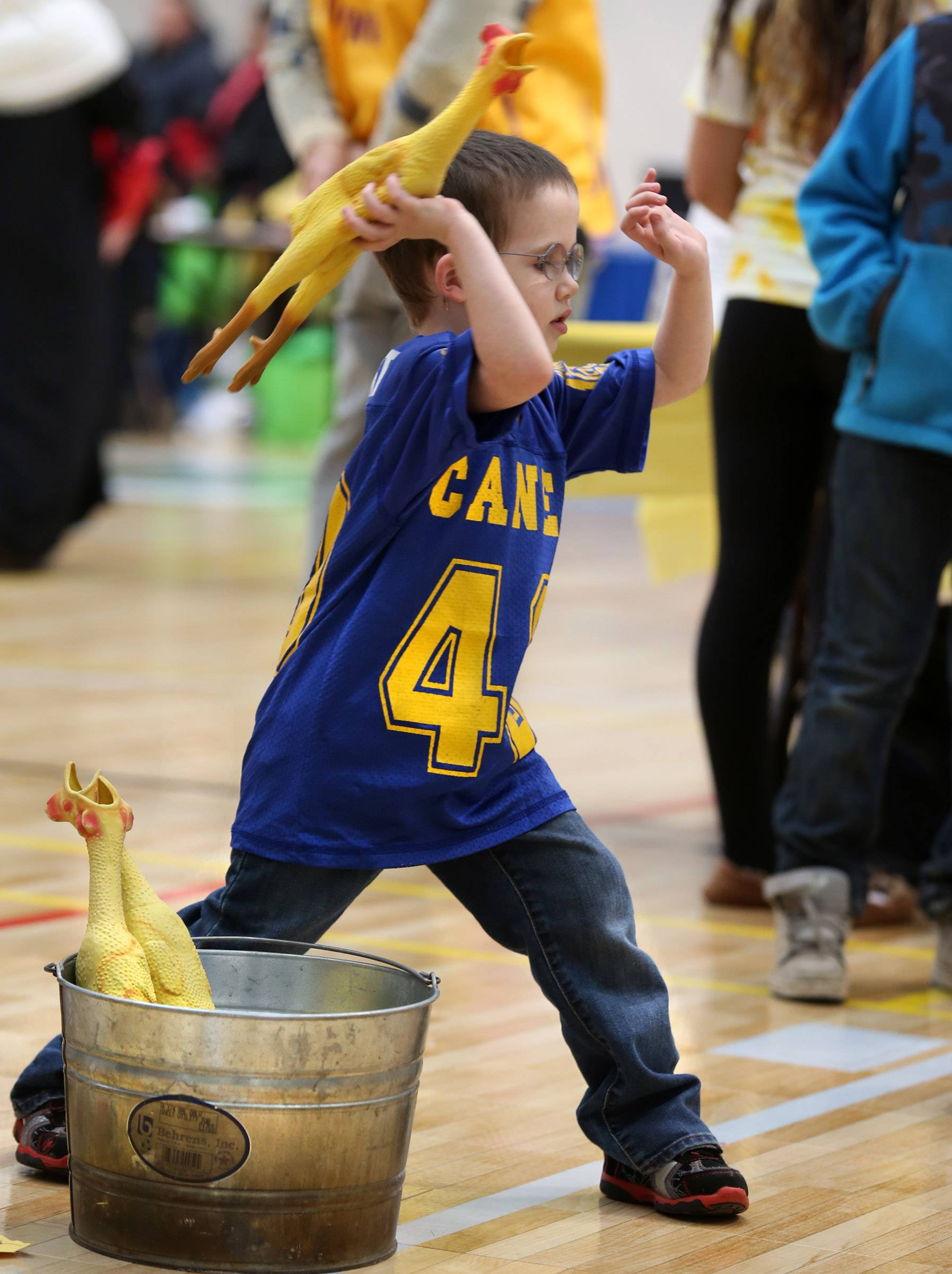 Matthew Weinert, 4, of Hanover Park, tosses a rubber chicken towards a basketball hoop at the Kids at Hope Community Resource Fair at Hanover Park's Community Center Gym on Saturday.
