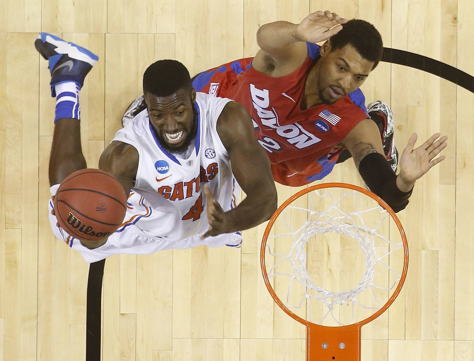 Florida center Patric Young (4) shoots against Dayton forward/center Jalen Robinson (12) during the first half in a regional final game at the NCAA college basketball tournament Saturday in Memphis, Tenn.