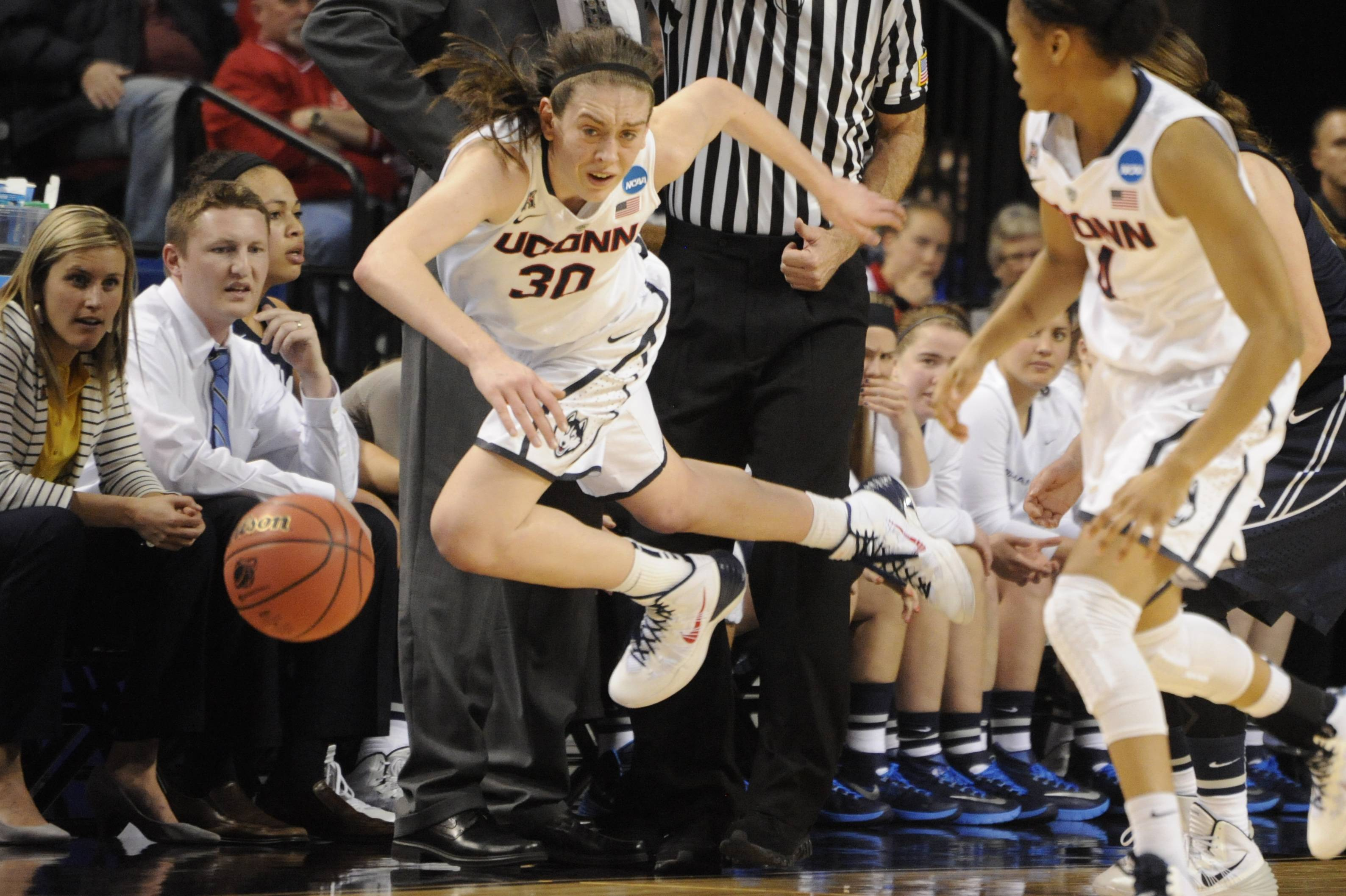 Connecticut's Breanna Stewart (30) tries to keep the ball in bounds during the second half against BYU in a regional semifinal in the NCAA women's college basketball tournament Saturday in Lincoln, Neb. Connecticut won 70-51.
