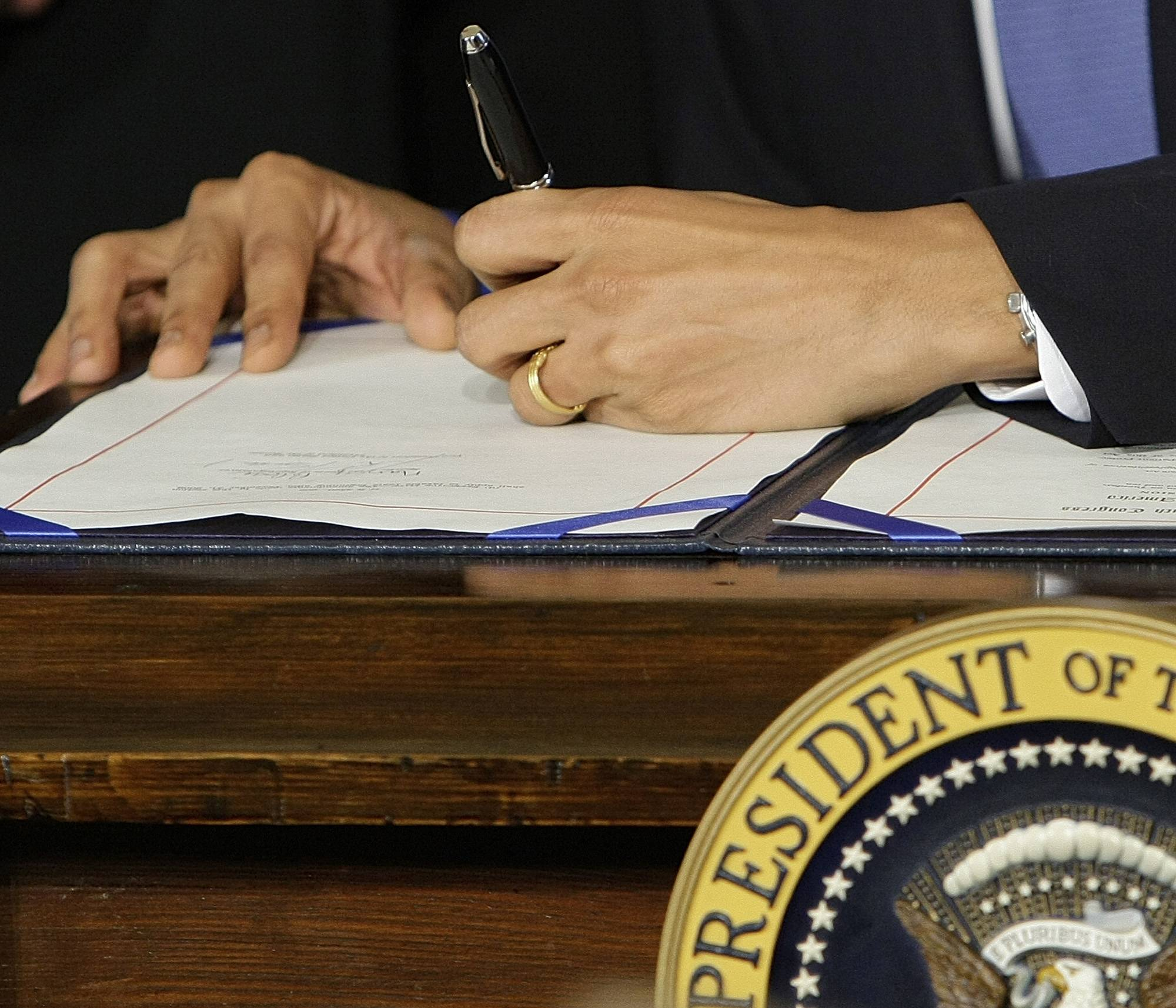 President Barack Obama signs the health care bill in the East Room of the White House in Washington.