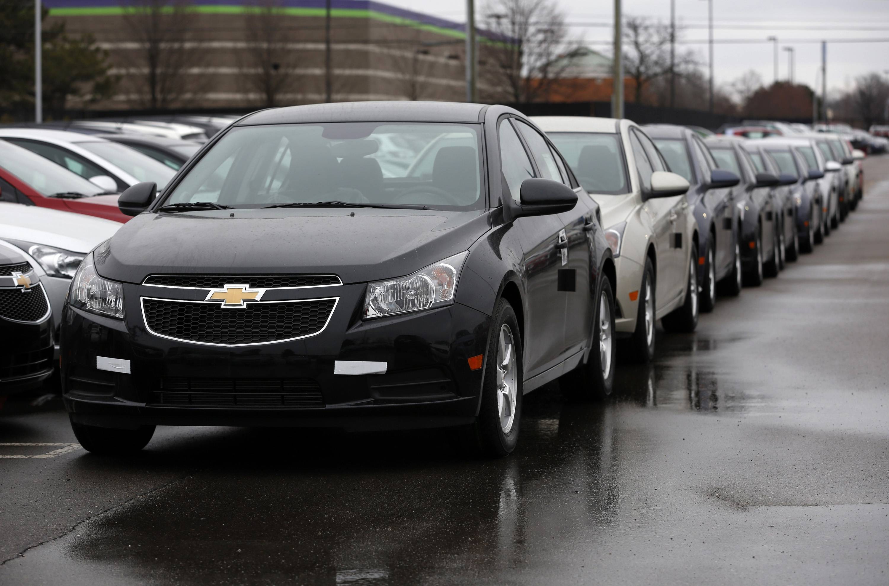 General Motors Co. 2014 Chevrolet Cruze vehicles sit on the lot Friday at a dealership in Southfield, Mich.