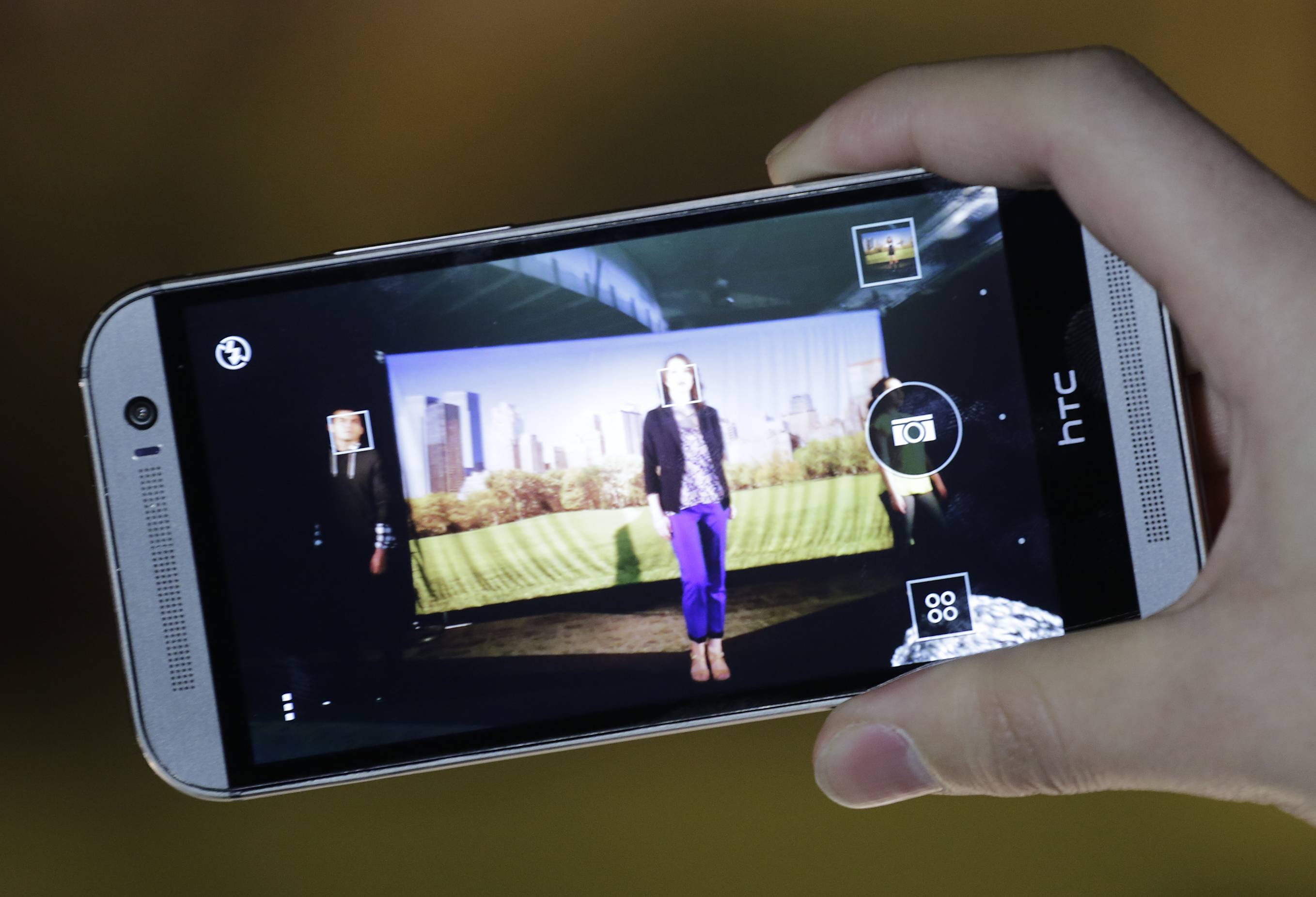 HTC is updating its flagship HTC One smartphone by giving it a larger screen, better software and a camera that's easier to use.