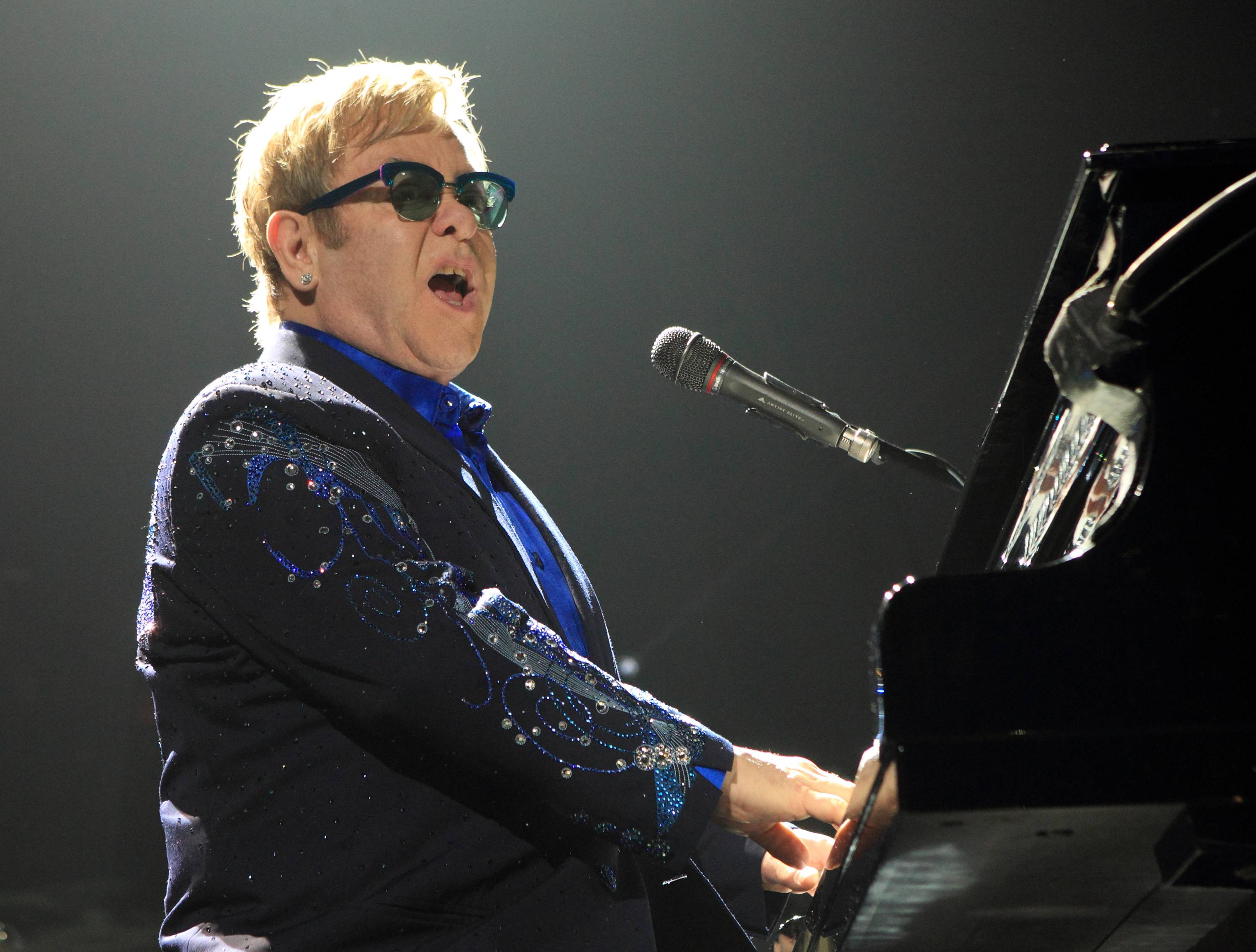 "Elton John performing in concert during his Diving Board Tour 2013 at the Verizon Center in Washington, D.C. Elton John released the 40th anniversary edition of his 1973 album, ""Goodbye Yellow Brick Road,"" on his 67th birthday."