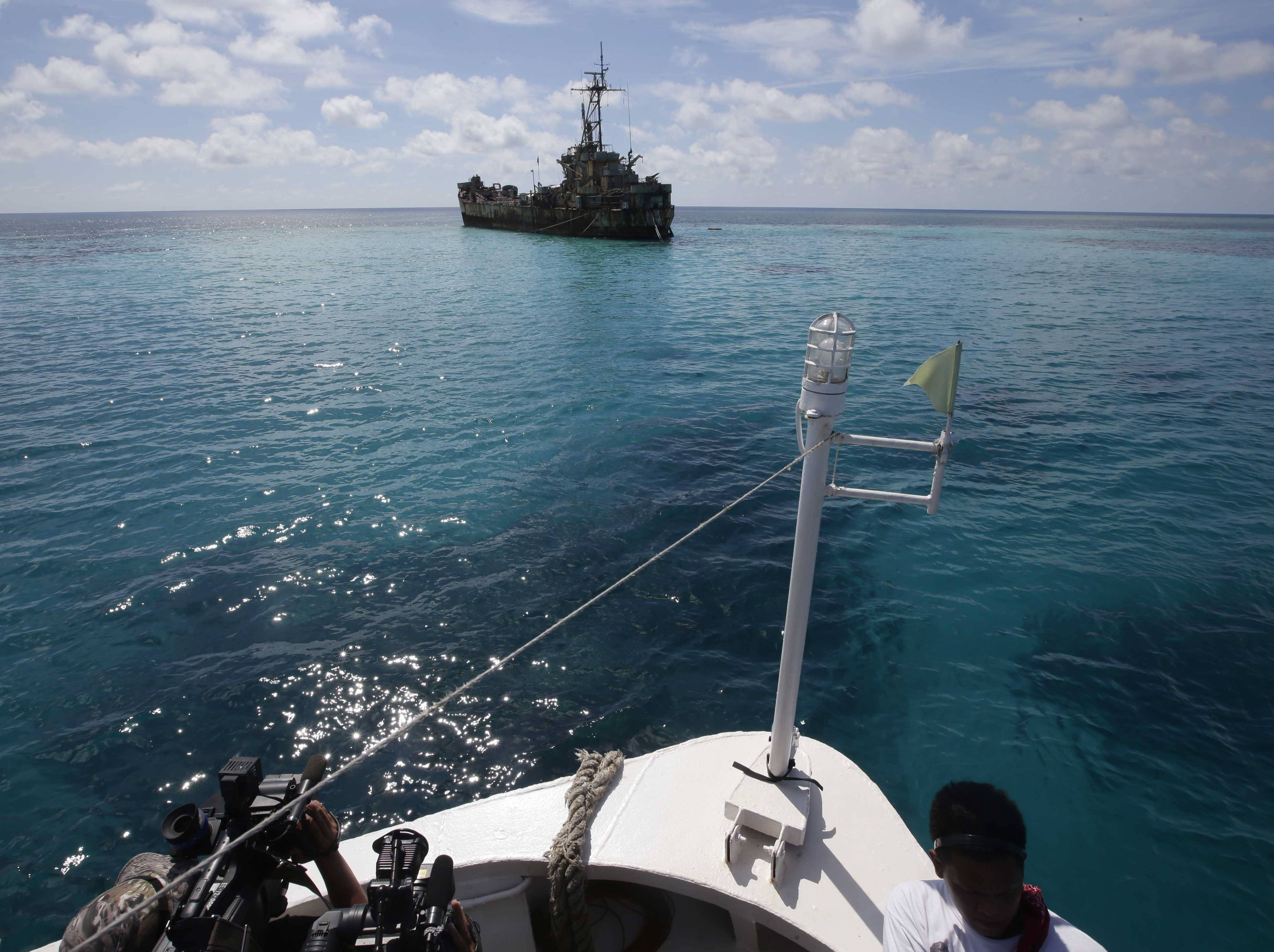A dilapidated Philippine Navy ship LT 57 (Sierra Madre) with Philippine troops deployed on board is anchored Saturdsy off Second Thomas Shoal in the South China Sea. An hour from the shoal, the Chinese coast guard ship closed in on the Philippines supply vessel and twice crossed its bow.
