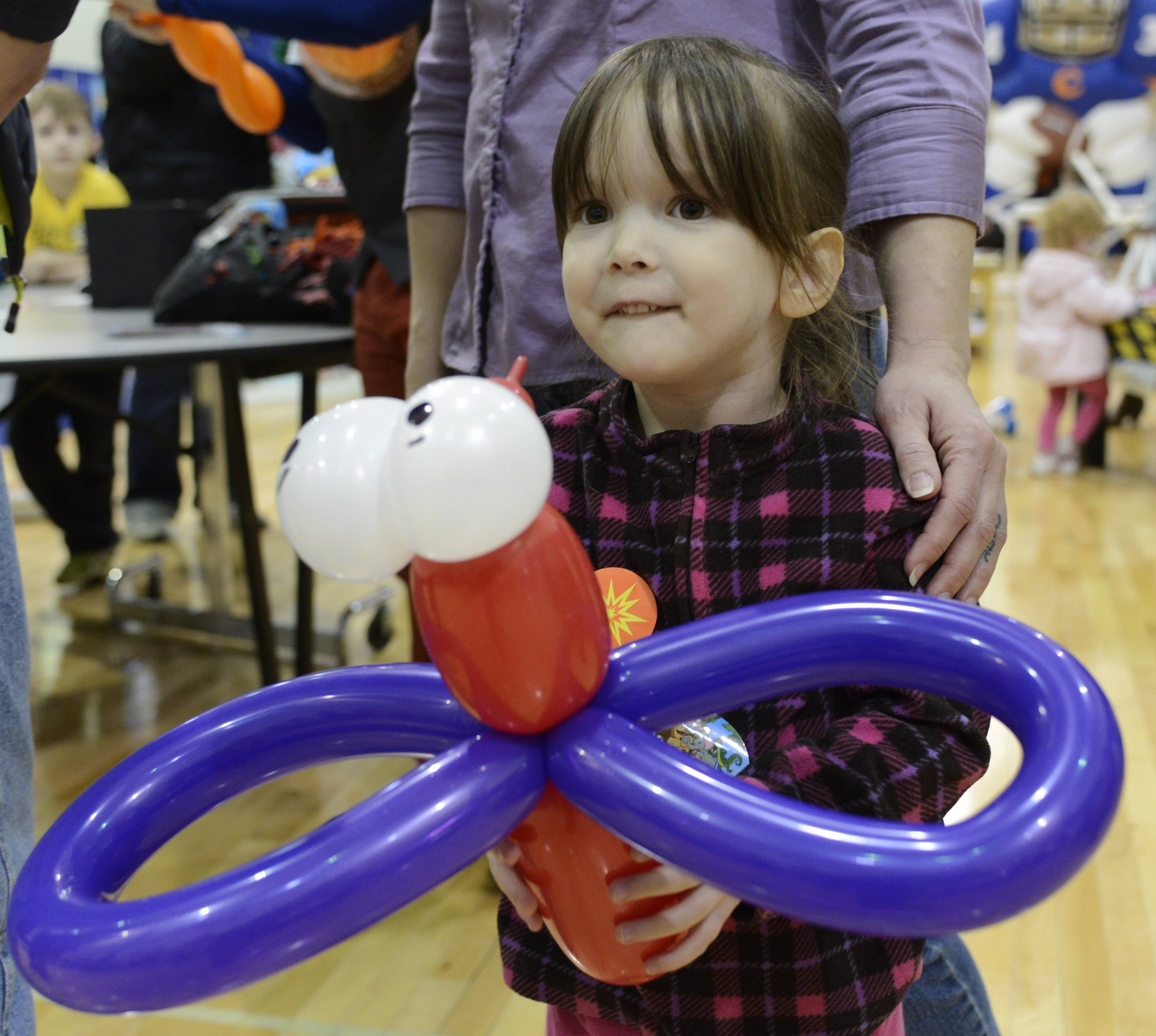 Sara Hawkins, 4, of Round Lake Beach carries a balloon animal that was made for her Saturday during the Springfest Expo 2014, held by the Lindenhurst-Lake Villa Chamber of Commerce at Lakes Community High School.