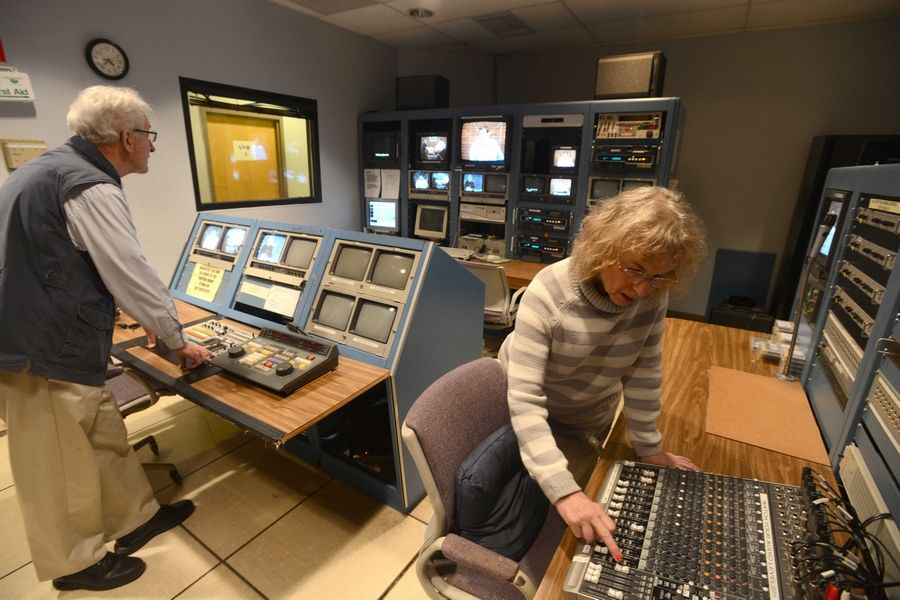 "Patrick Kunzer/pkunzer@dailyherald.comDirector George Clowes, left, and producer Roberta Markbreit, right, fine tune settings in the control room during a taping of the public access show ""Talking Sports"" at the Comcast studio facility in Skokie on Monday afternoon."