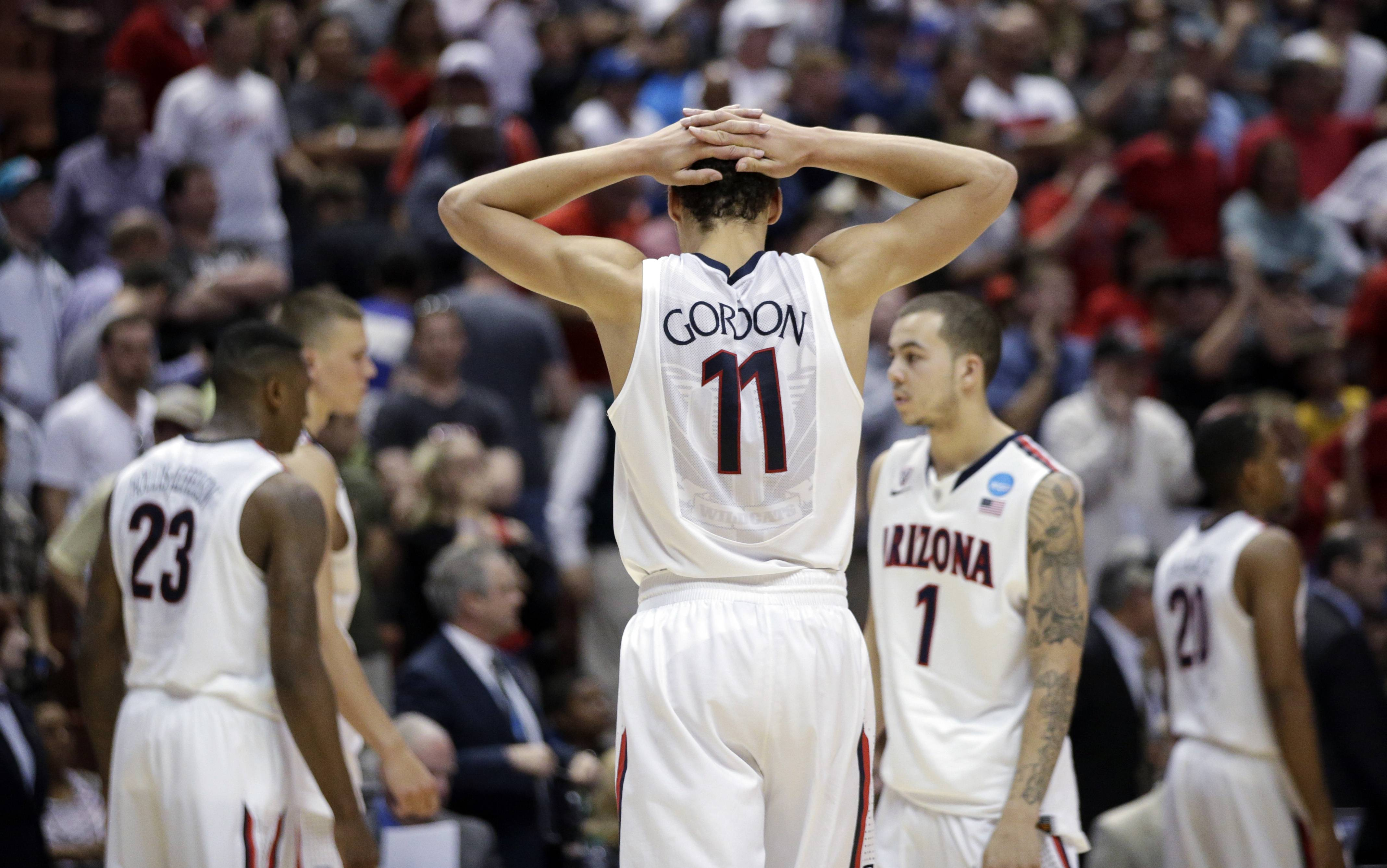 Arizona's Aaron Gordon reacts after his team's overtime loss against Wisconsin.
