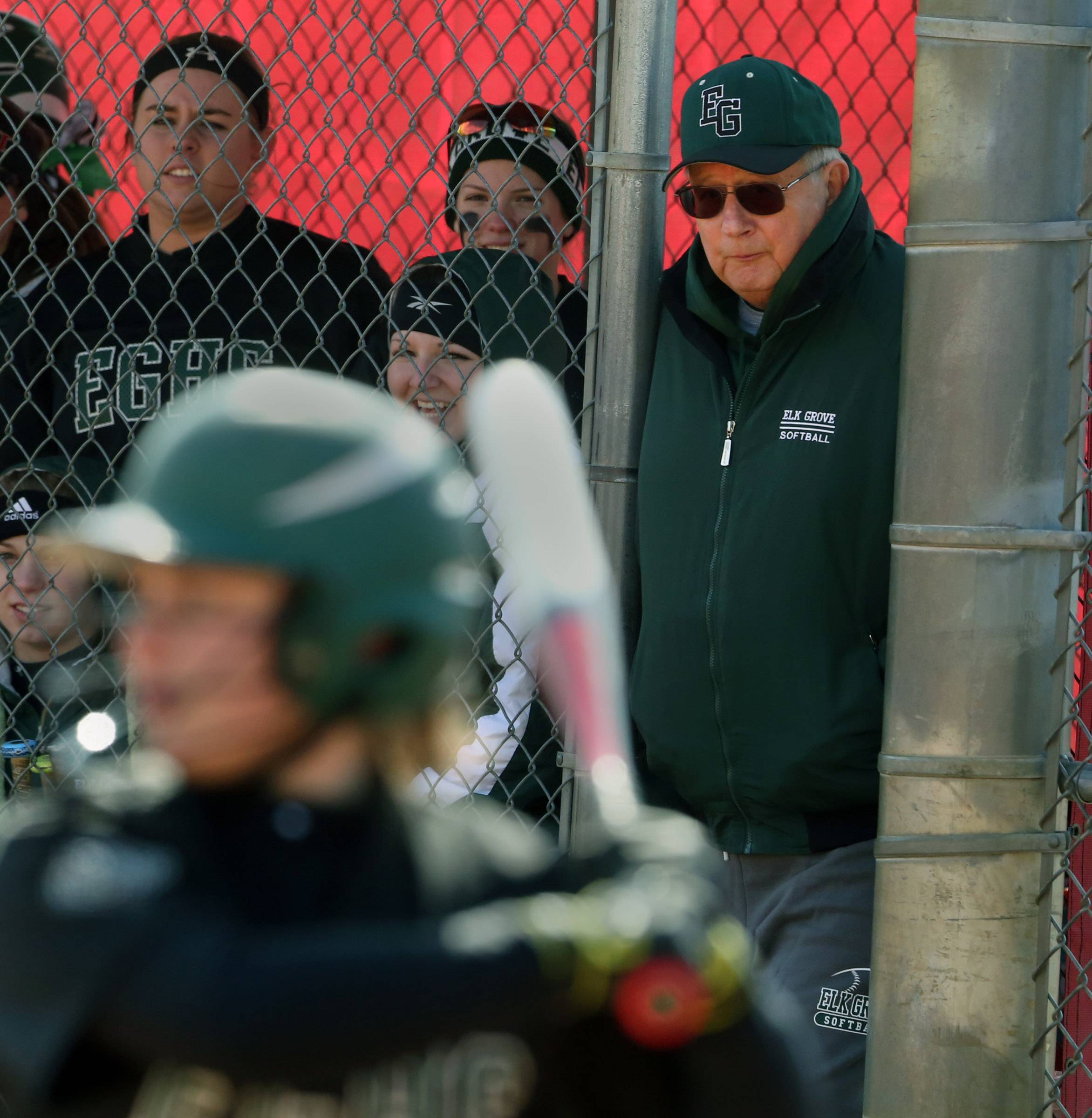 Elk Grove softball coach Ken Grams as the team plays against Mundelein at the Fields of Dreams on Saturday in Barrington.