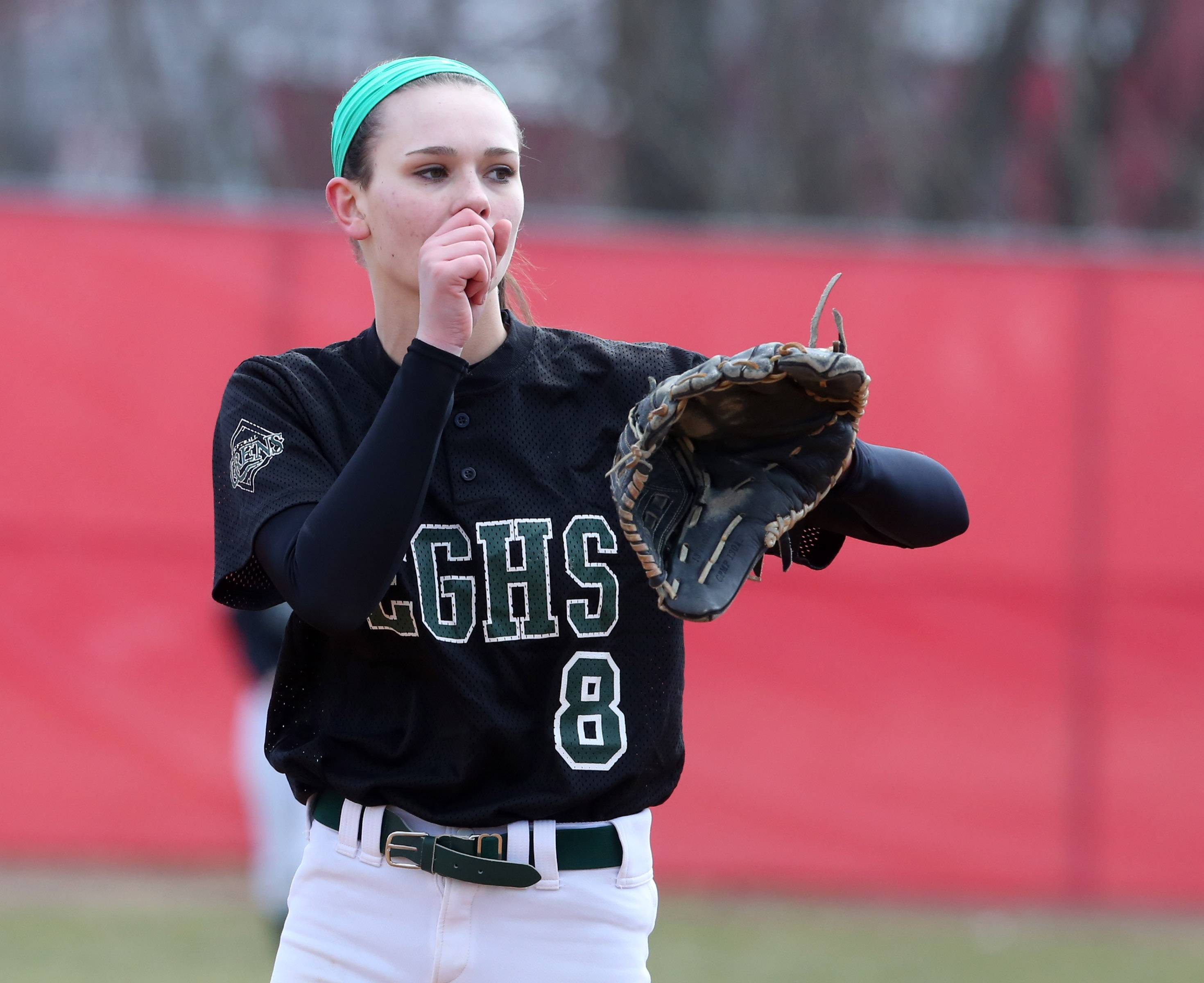 Elk Grove pitcher Megan Eul facing Mundelein warms her hand at the Fields of Dreams on Saturday in Barrington.