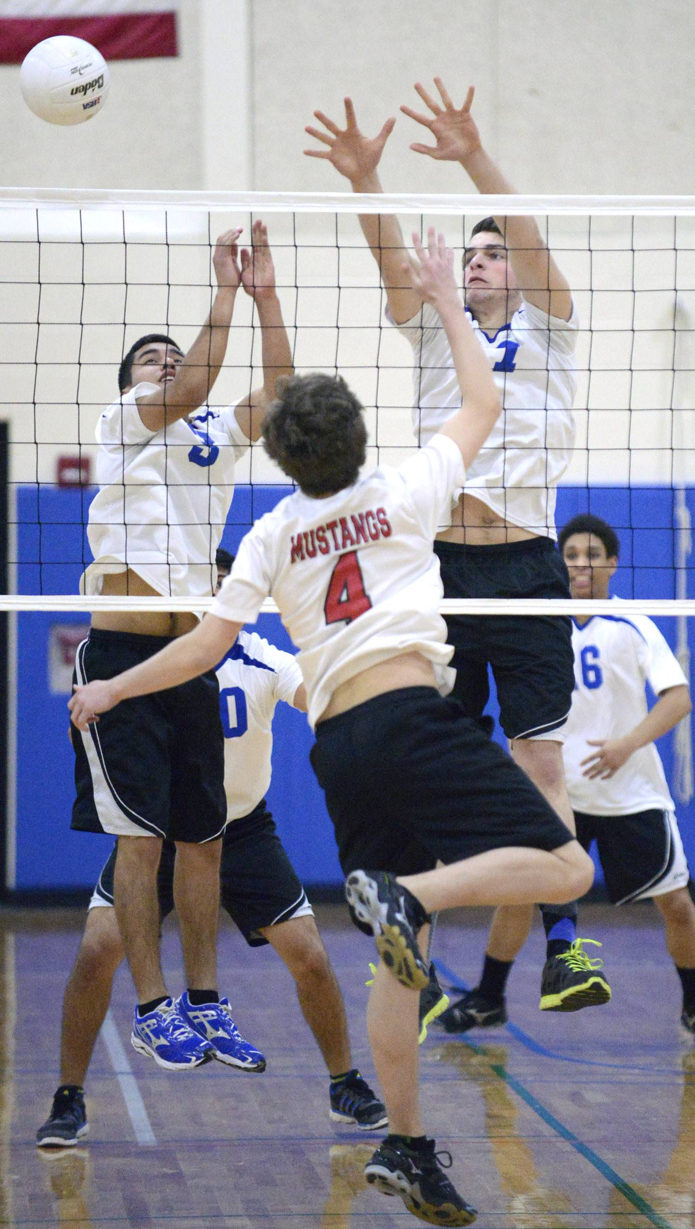 Larkin's Rudy Hernandez, left, and Victor Vyleta block a shot by Mundelein's Sam Nelson at Hoffman Estates on Saturday.