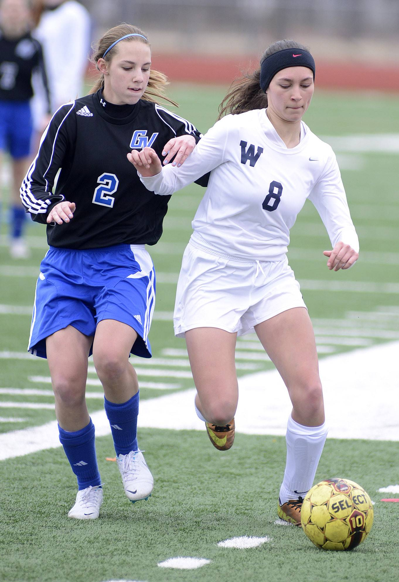 Geneva's Allie Mikos, left, and West Aurora's Mariyah Zeitz battle for the ball near the boundary line in the first half in Aurora on Saturday, March 29.