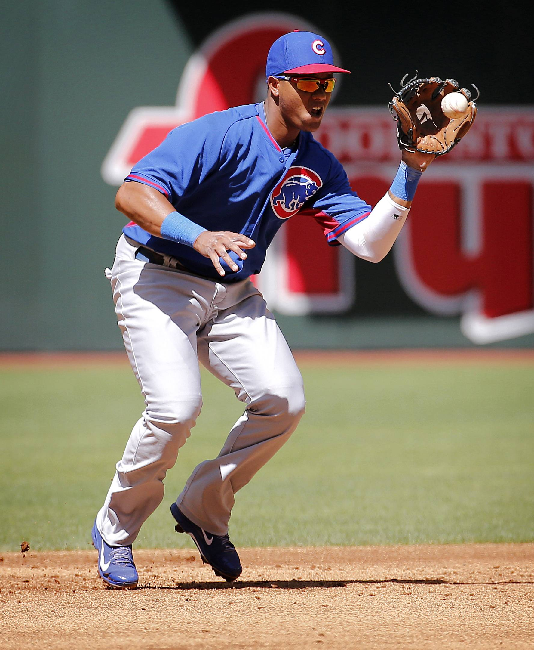 The Cubs' Starlin Castro fields a ground out hit by the Arizona Diamondbacks' Eric Chavez during Saturday's exhibition spring training game in Phoenix. The Cubs won 9-8.