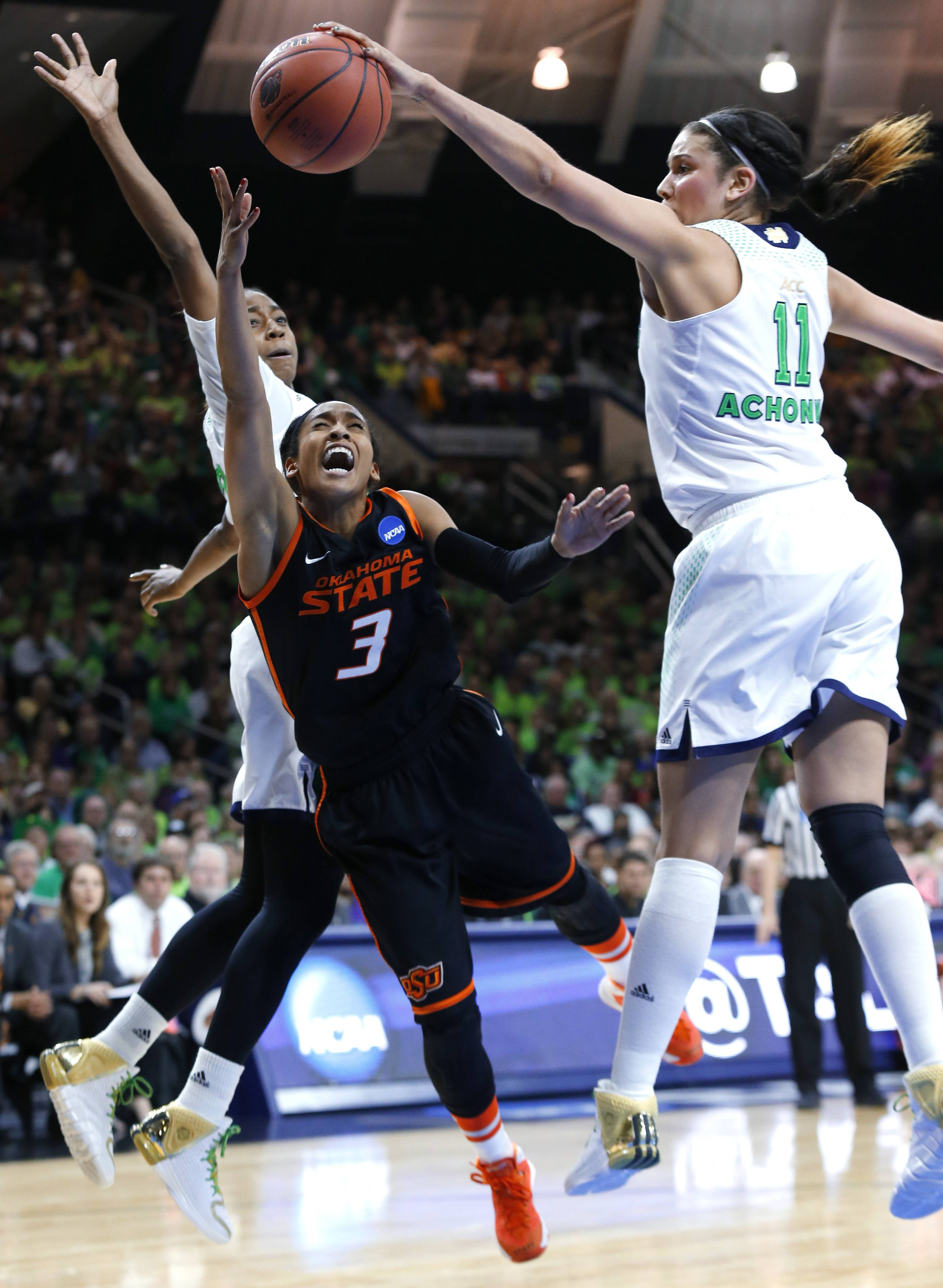 Notre Dame forward Natalie Achonwa (11) blocks a shot by Oklahoma State guard Tiffany Bias (3) as guard Jewell Loyd, at rear, helps to defend during the second half of a regional semifinal in the NCAA college basketball tournament at the Purcell Pavilion in South Bend, Ind., Saturday.