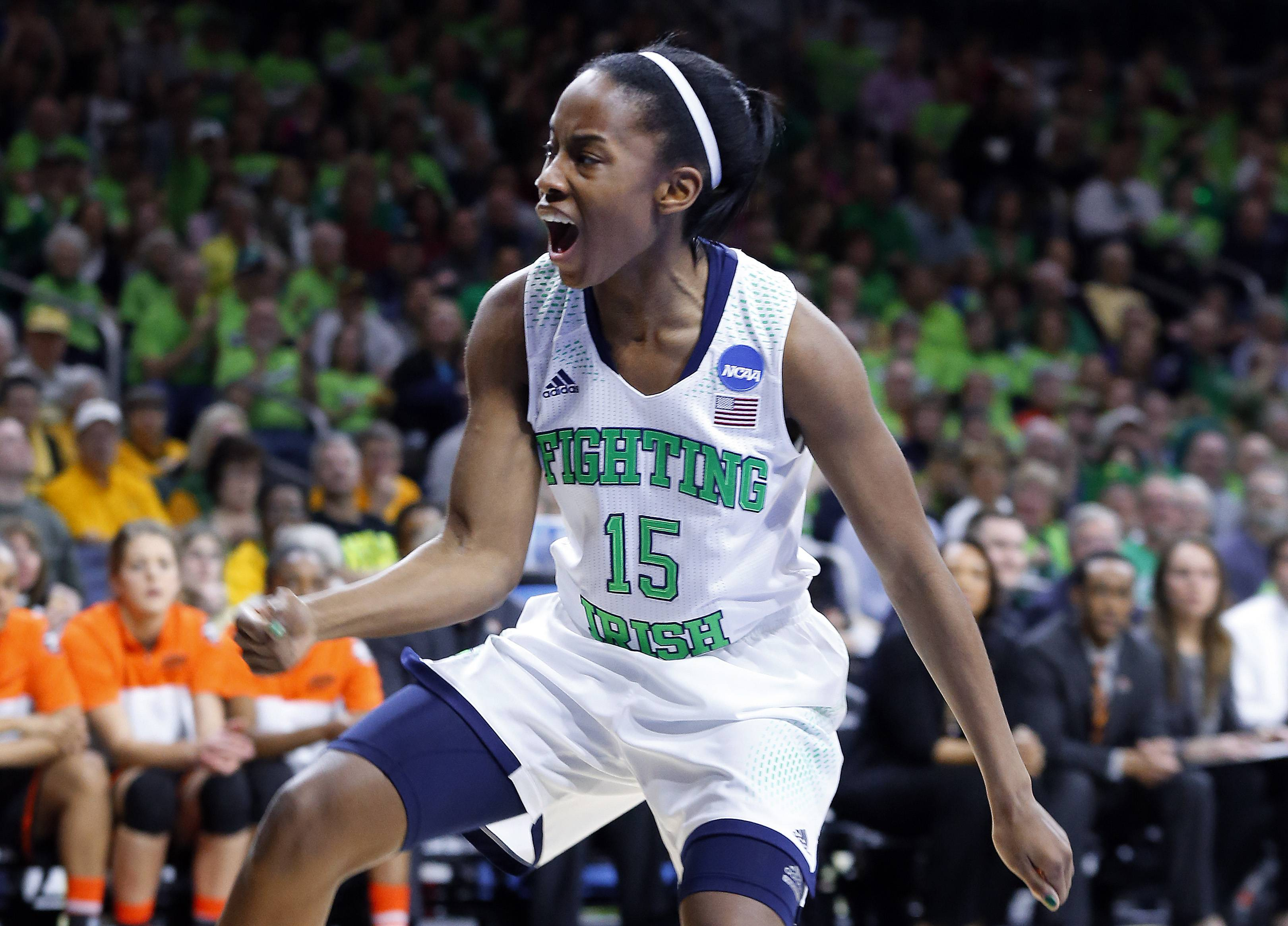 Notre Dame guard Lindsay Allen (15) celebrates a basket against Oklahoma State during the first half.