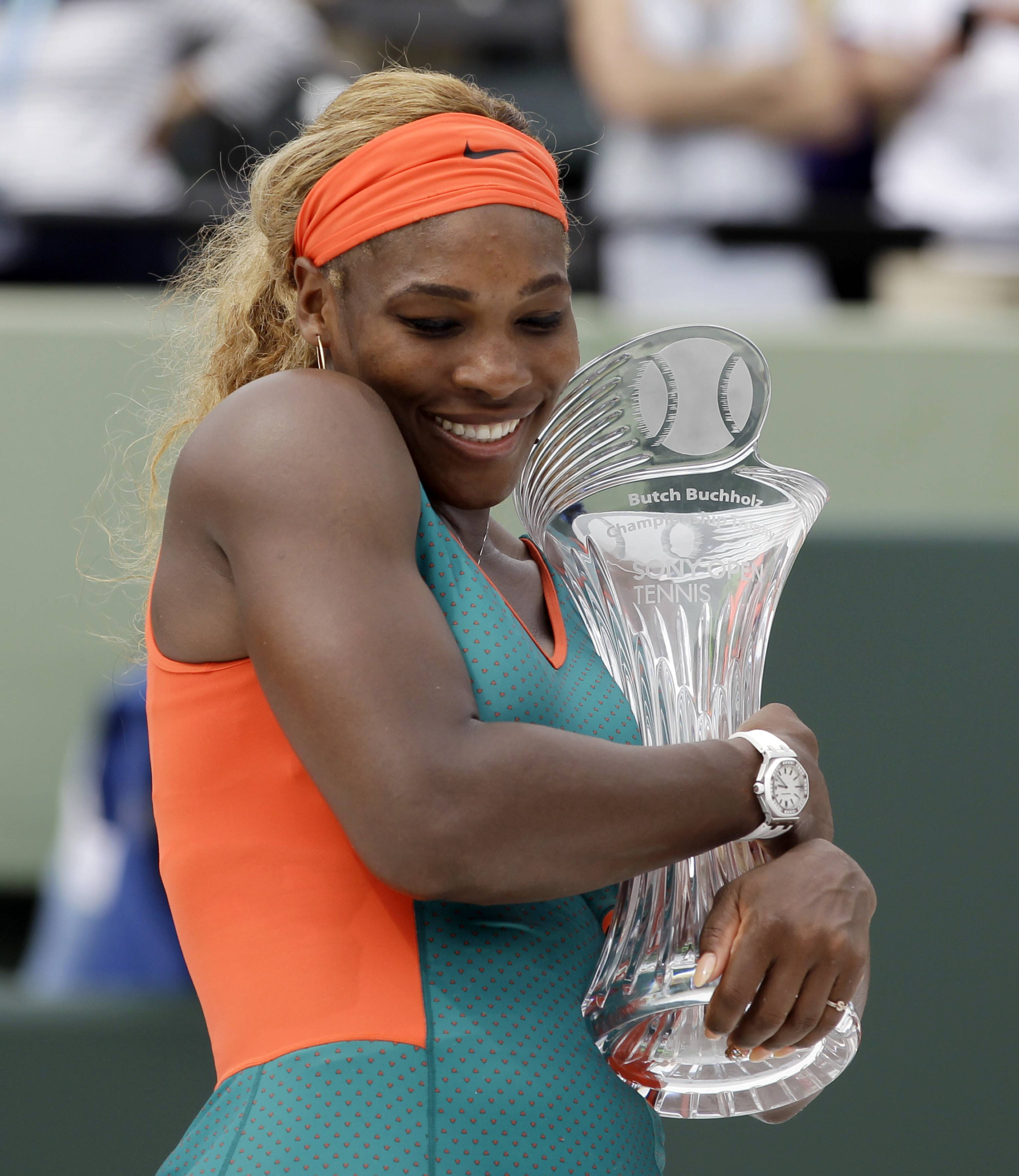 Serena Williams, of the United States, hugs the the trophy as she poses for photos after defeating Li Na, of China, in the women's final 7-5, 6-1 at the Sony Open Tennis tournament in Key Biscayne, Fla., Saturday.