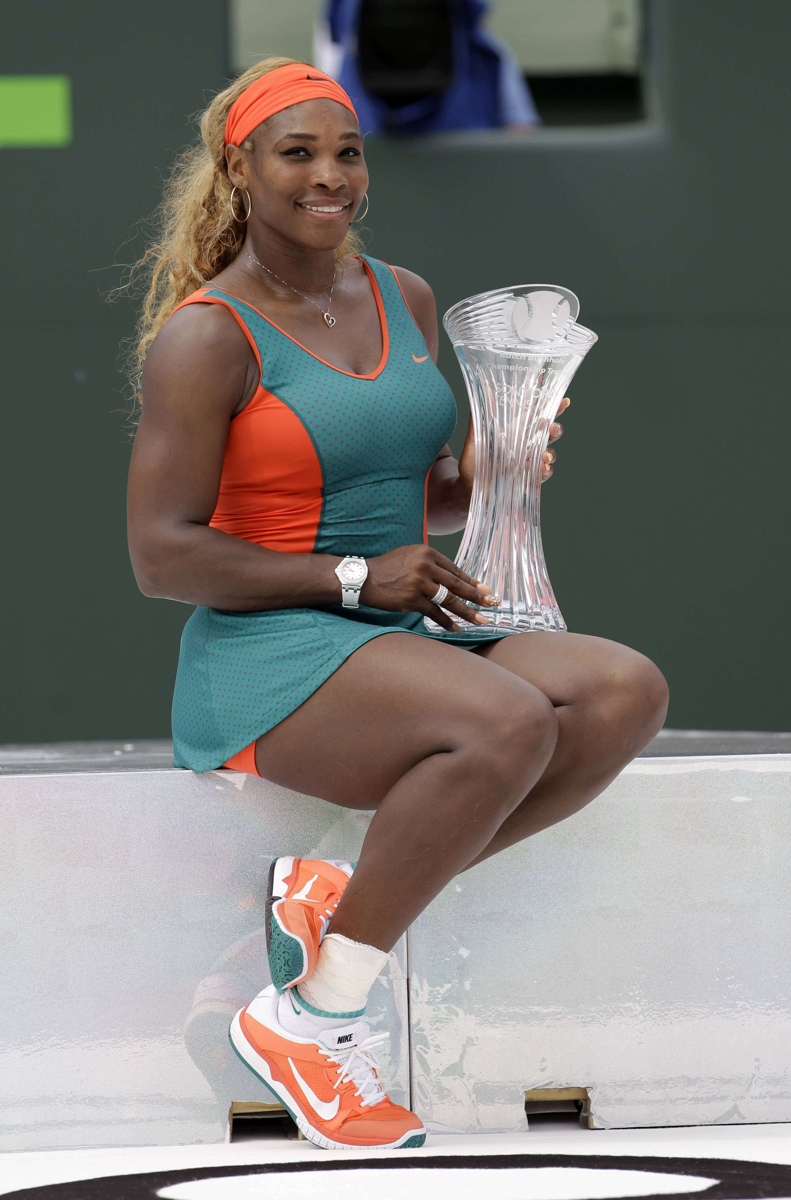 Serena Williams, of the United States, poses with the trophy after defeating Li Na, of China, in the women's final 7-5, 6-1 at the Sony Open Tennis tournament in Key Biscayne, Fla.