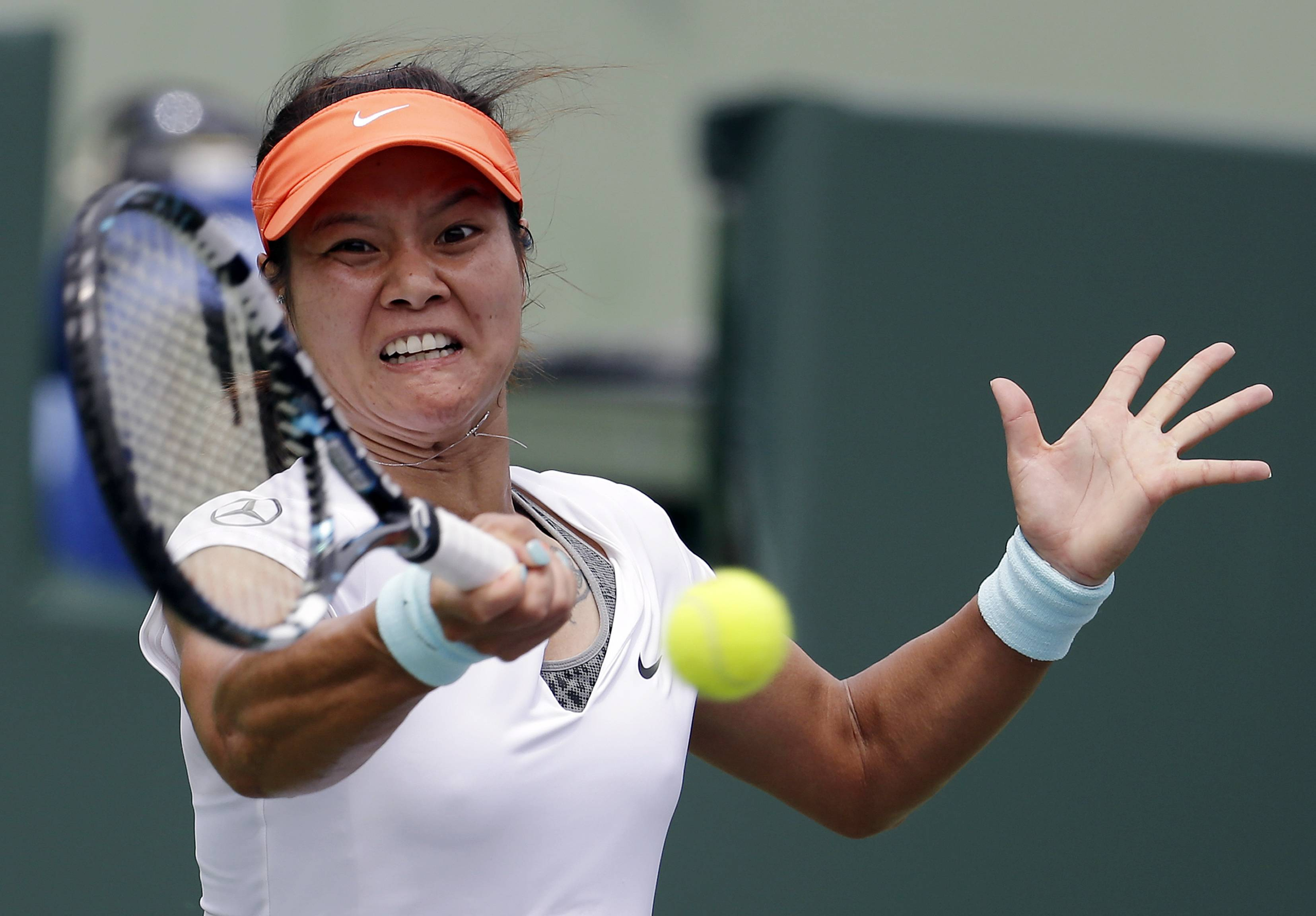 Li Na, of China,  returns to Serena Williams during the final at the Sony Open Tennis tournament.