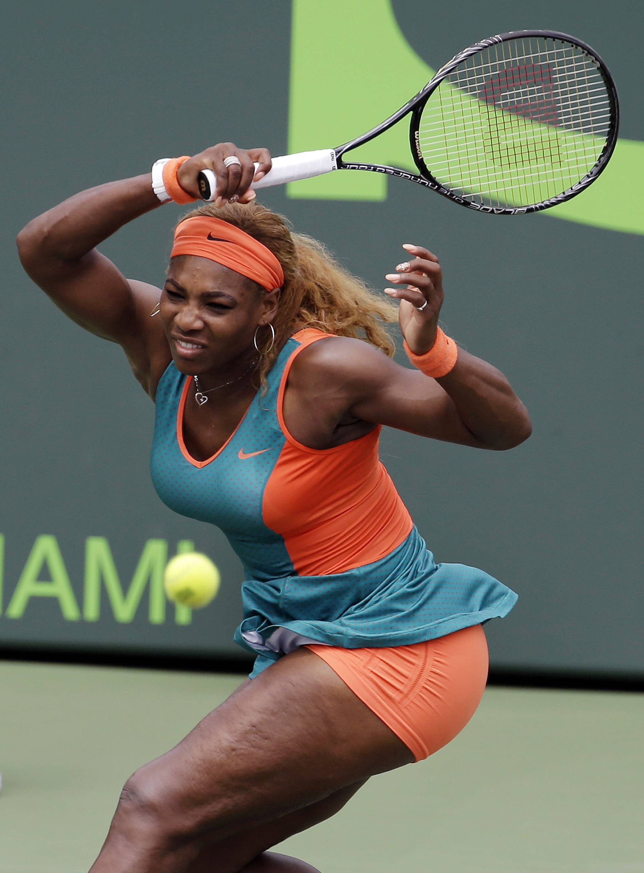 Serena Williams returns to Li Na, of China, during the women's final at the Sony Open Tennis tournament.