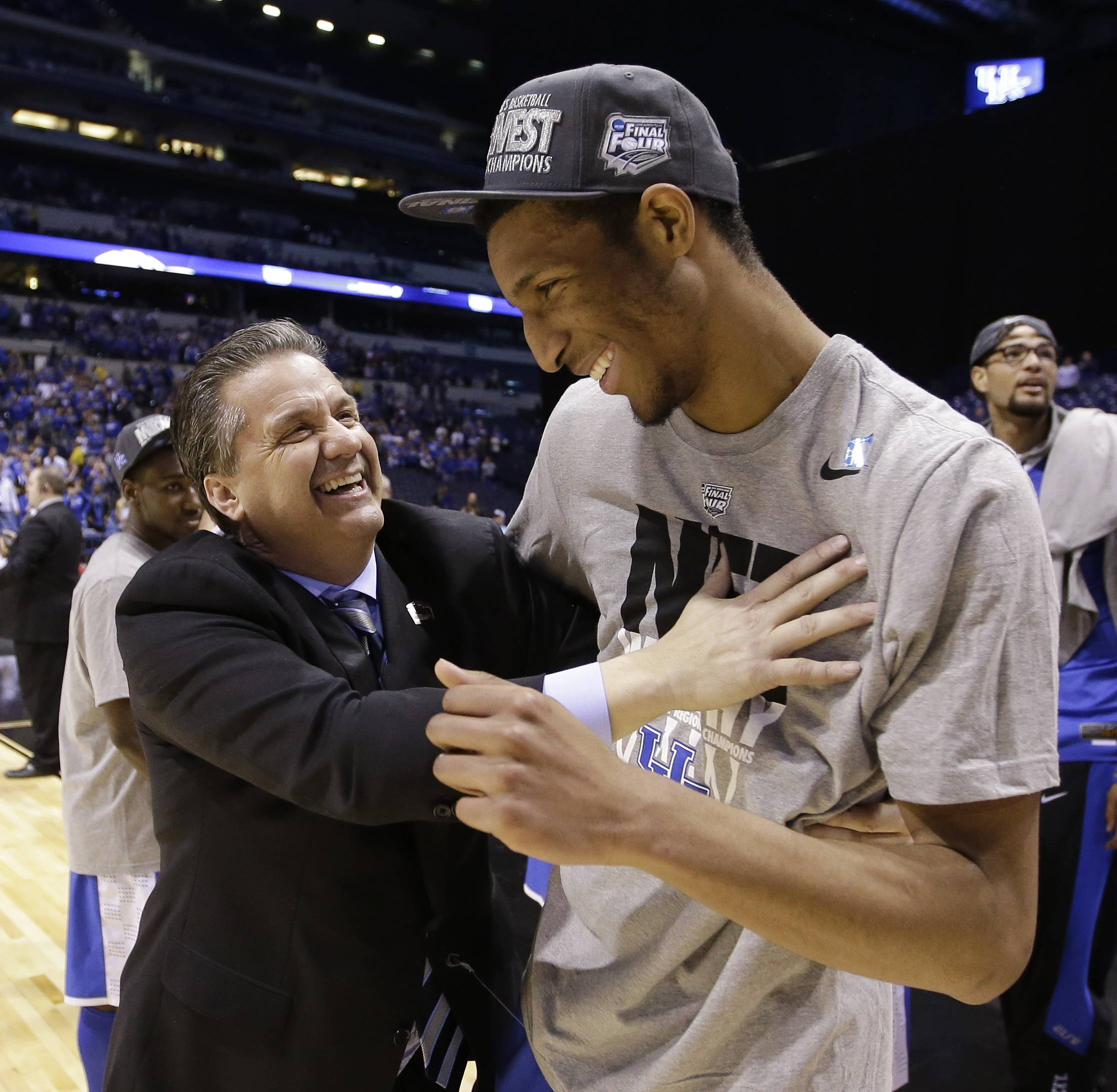 Kentucky head coach John Calipari, left, celebrates with Marcus Lee after an NCAA Midwest Regional final college basketball tournament game Sunday, March 30, 2014, in Indianapolis. Kentucky won 75-72 to advance to the Final Four.