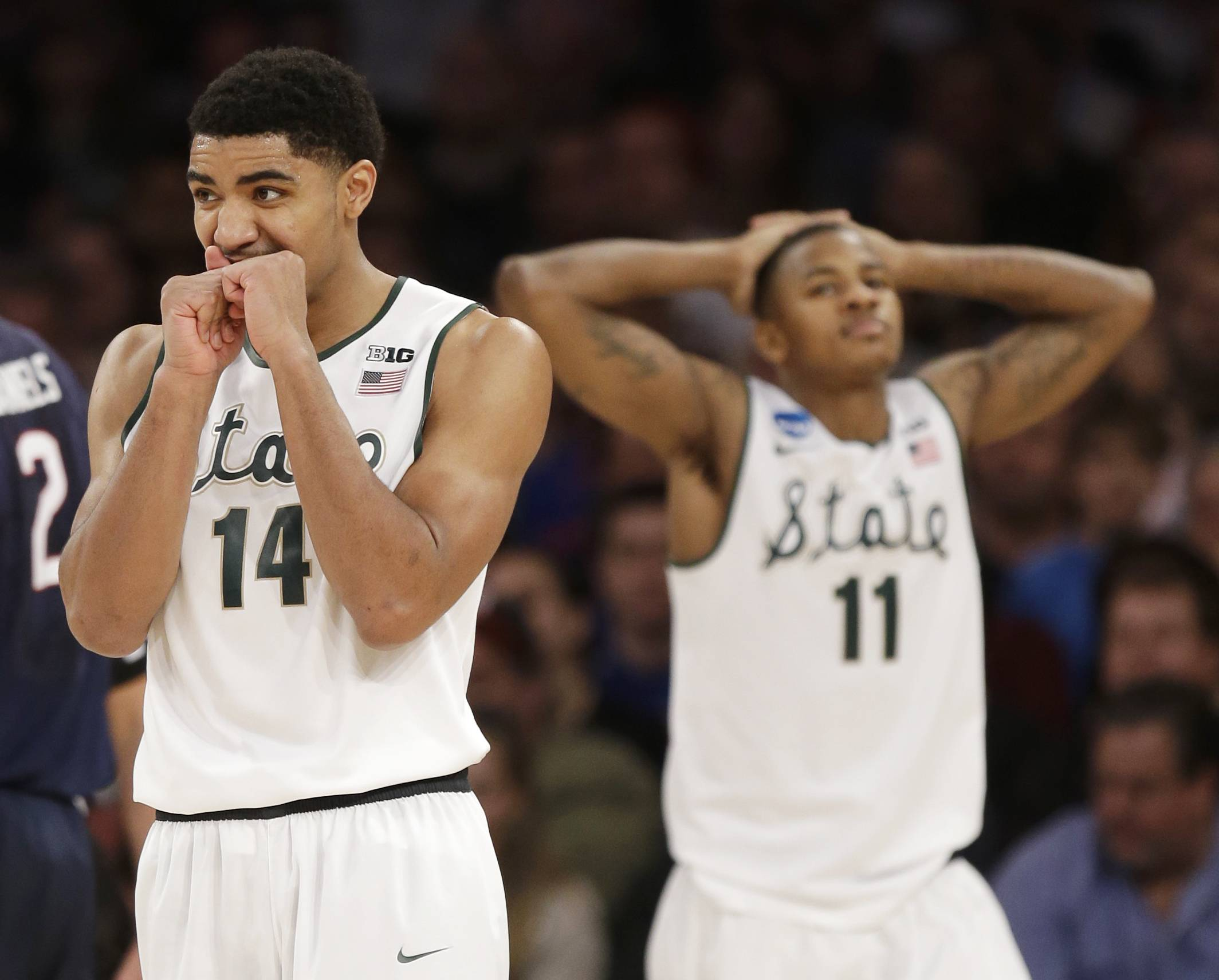 Michigan State's Gary Harris and Keith Appling react in the second half of a regional final against Connecticut at the NCAA college basketball tournament on Sunday, March 30, 2014, in New York.
