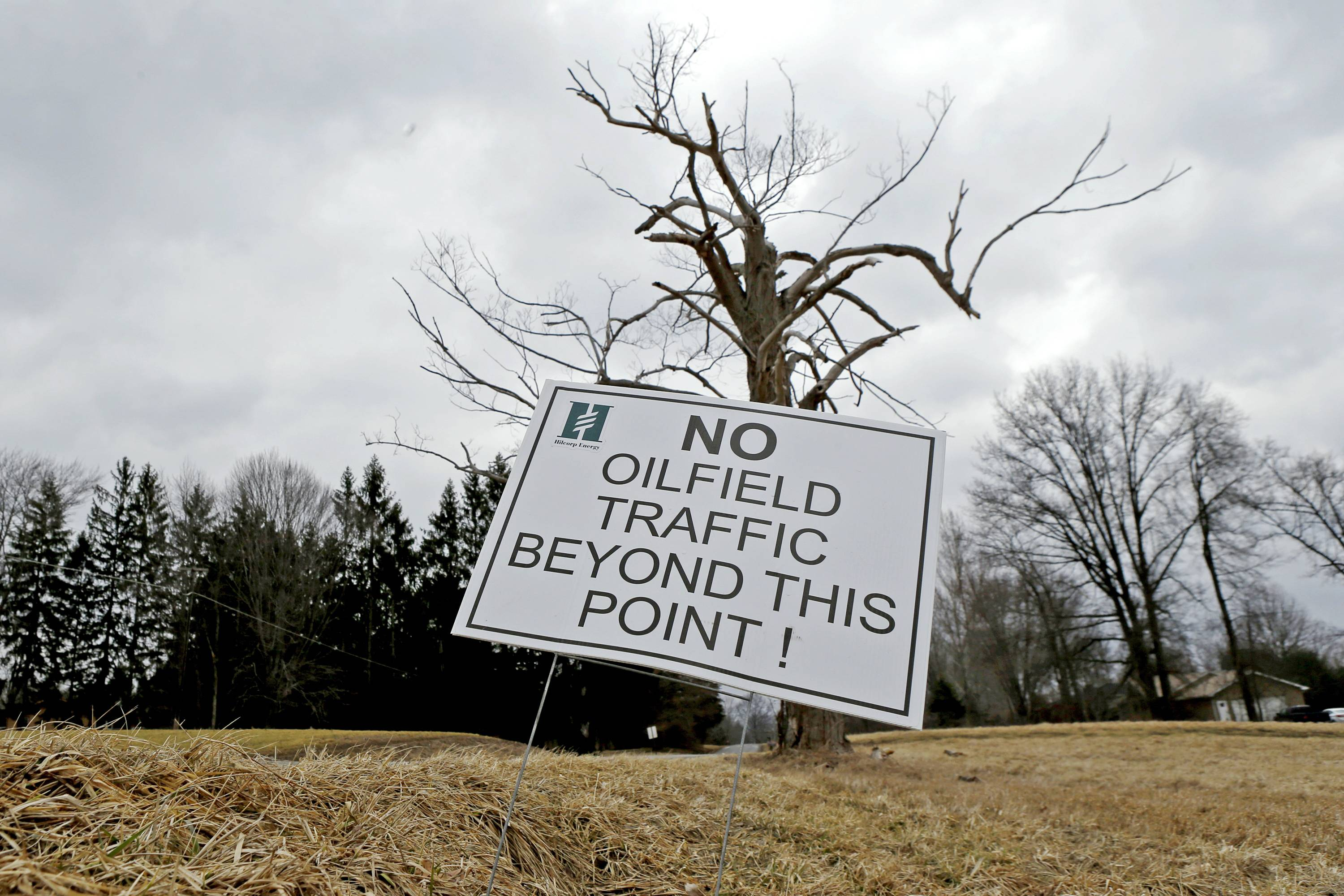 A sign near a gas well drilling site is seen near a road in Pulaski, Pa. The gas drilling company Hilcorp that is working the well has asked state officials to invoke a 1961 law in the rural area and allow Utica Shale well bores under the property of four landowners who have not signed leases.