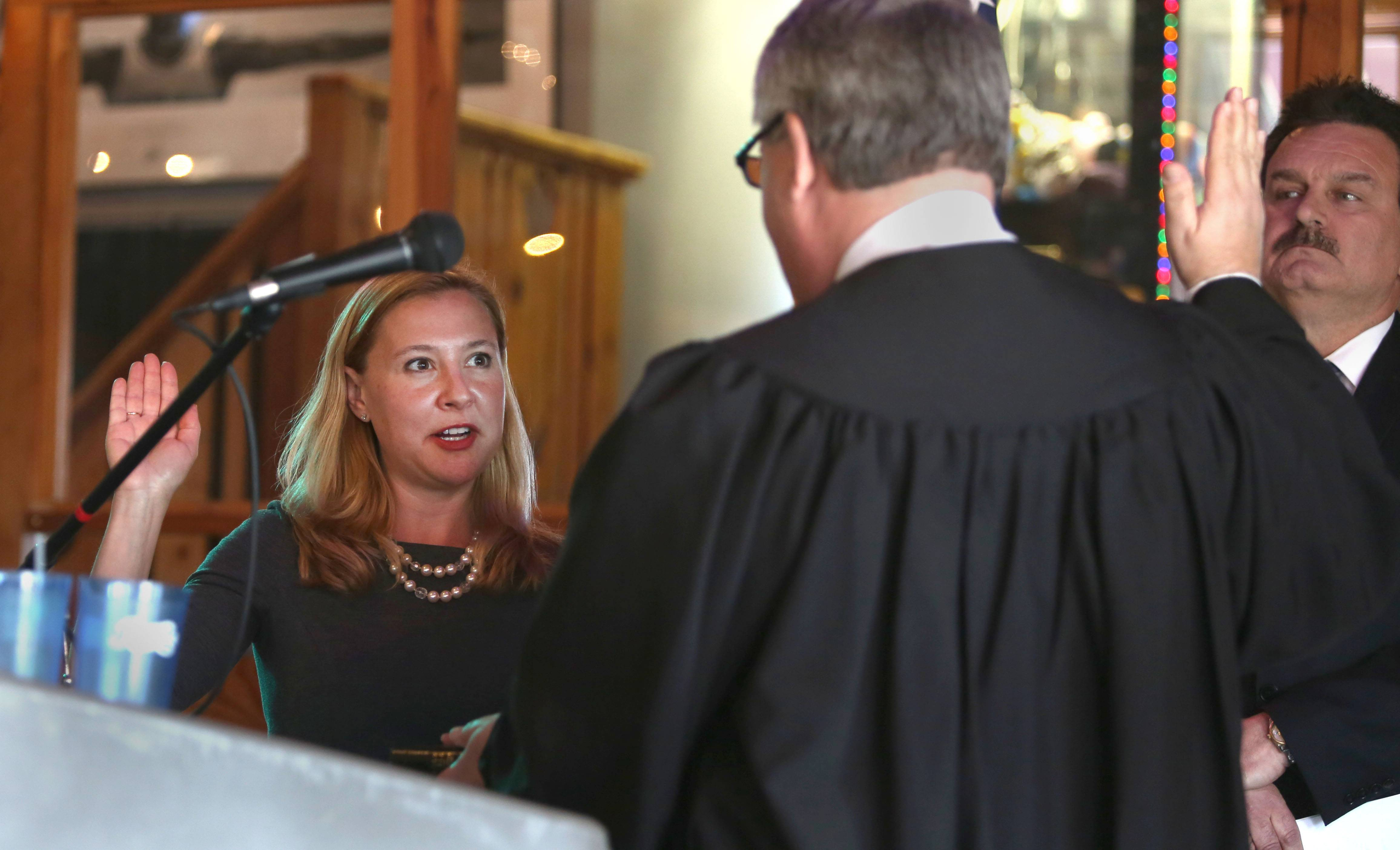 Judge John G. Dolton swears in Anna Moeller as the new state representative for the 43rd District. Moeller, who recently resigned from the Elgin City Council, said she plans to run for election in November.