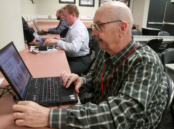 Daily Herald reporter Tim Sassone spent many long days working in the Blackhawks media room before games.