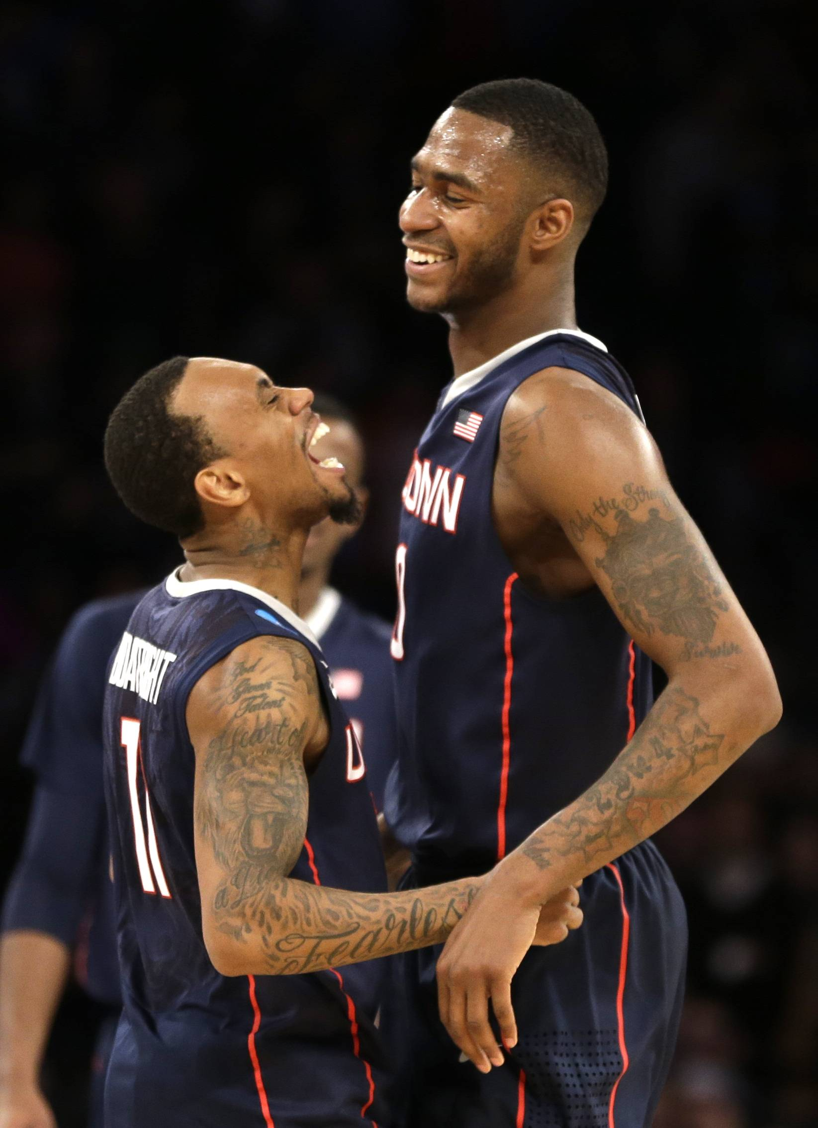 Connecticut's Ryan Boatright, left, and Phillip Nolan celebrate after defeating Michigan State in the regional final at the NCAA college basketball tournament on Sunday, March 30, 2014, in New York.