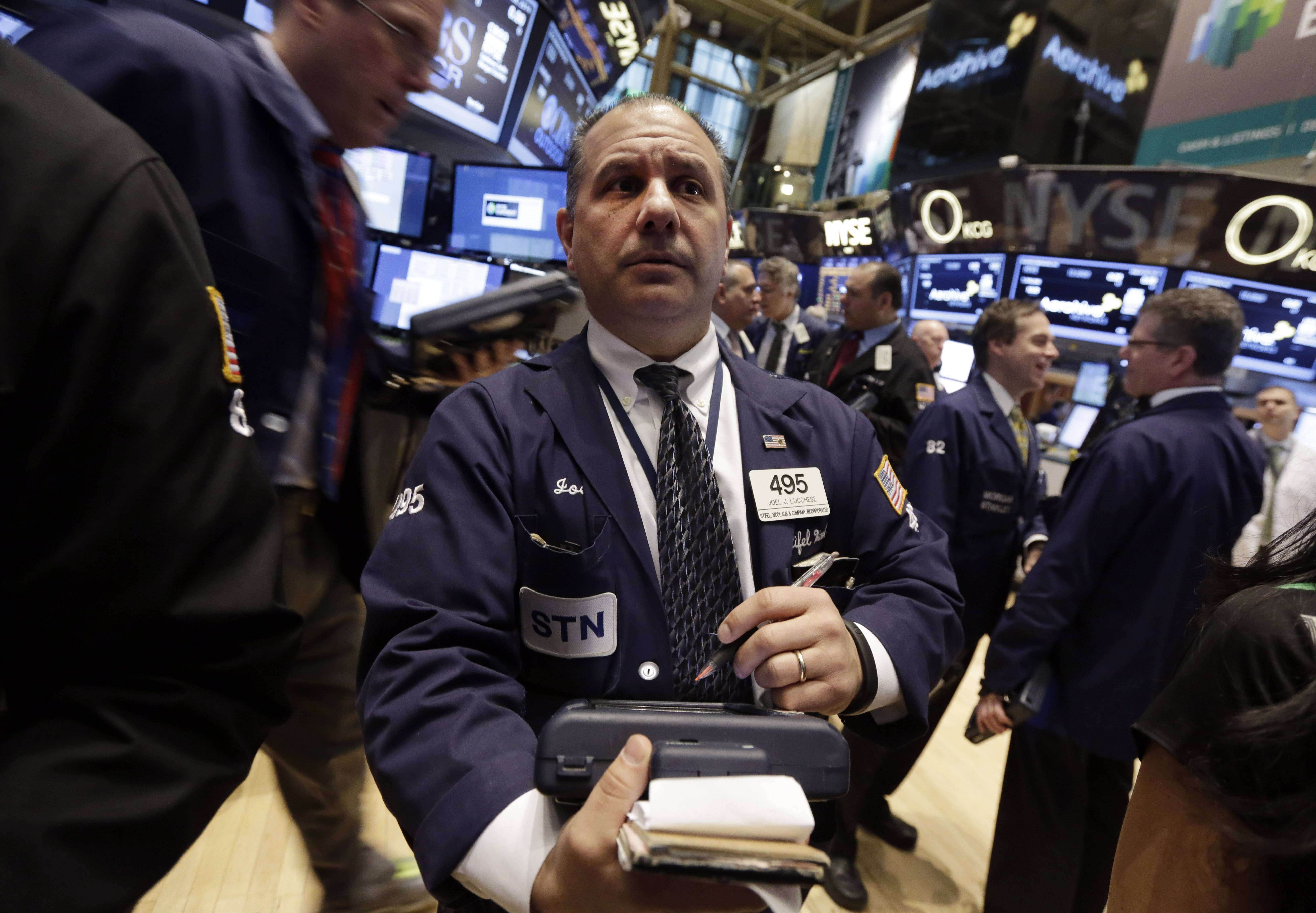 Stocks climbed Monday, with the Standard & Poor's 500 Index posting a fifth quarterly gain, as Federal Reserve Chair Janet Yellen signaled continued monetary support and tensions appeared to ease in Ukraine.