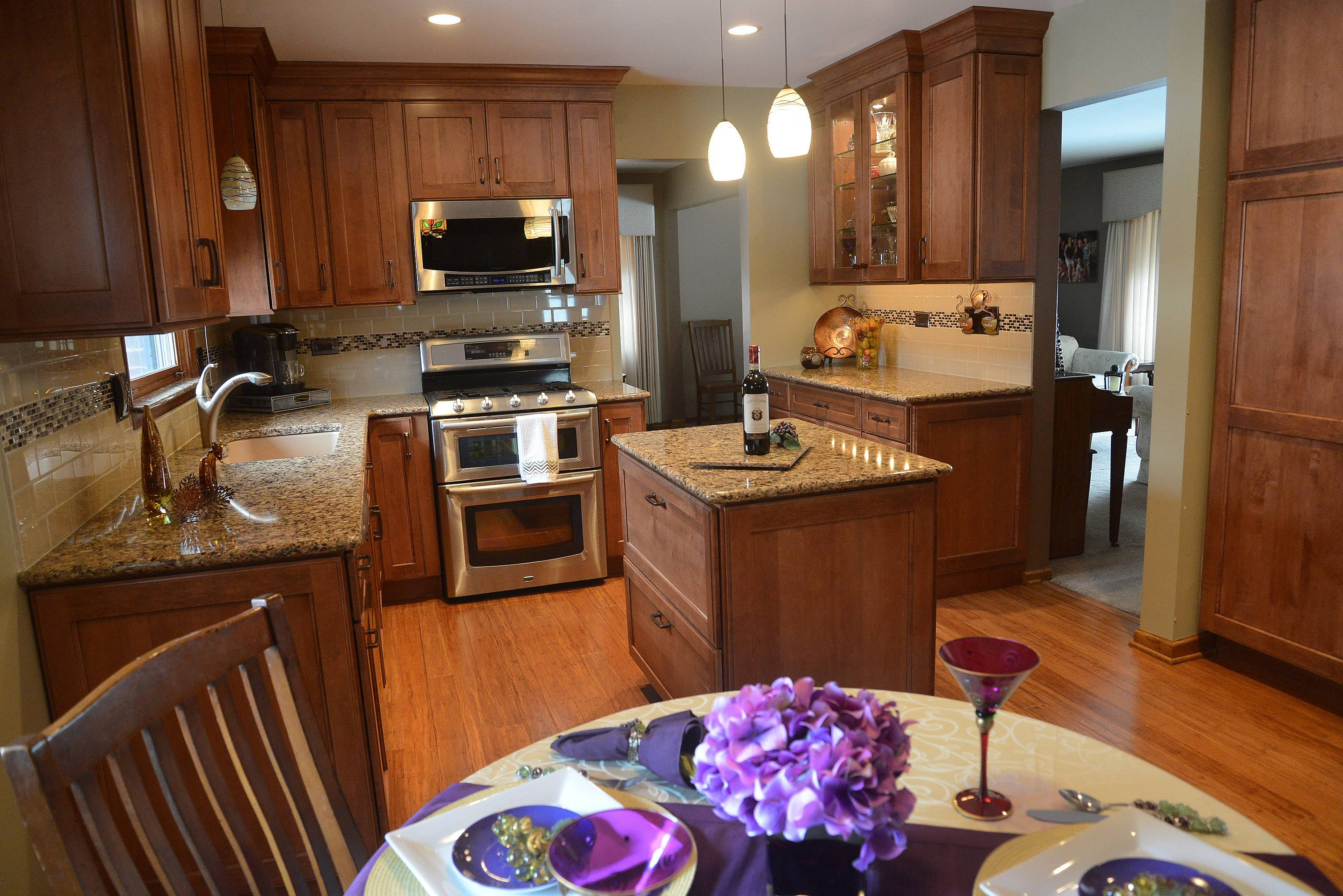 Designer Linda Navara and homeowner Maureen Willenborg in the newly redesigned kitchen in Arlington Heights.