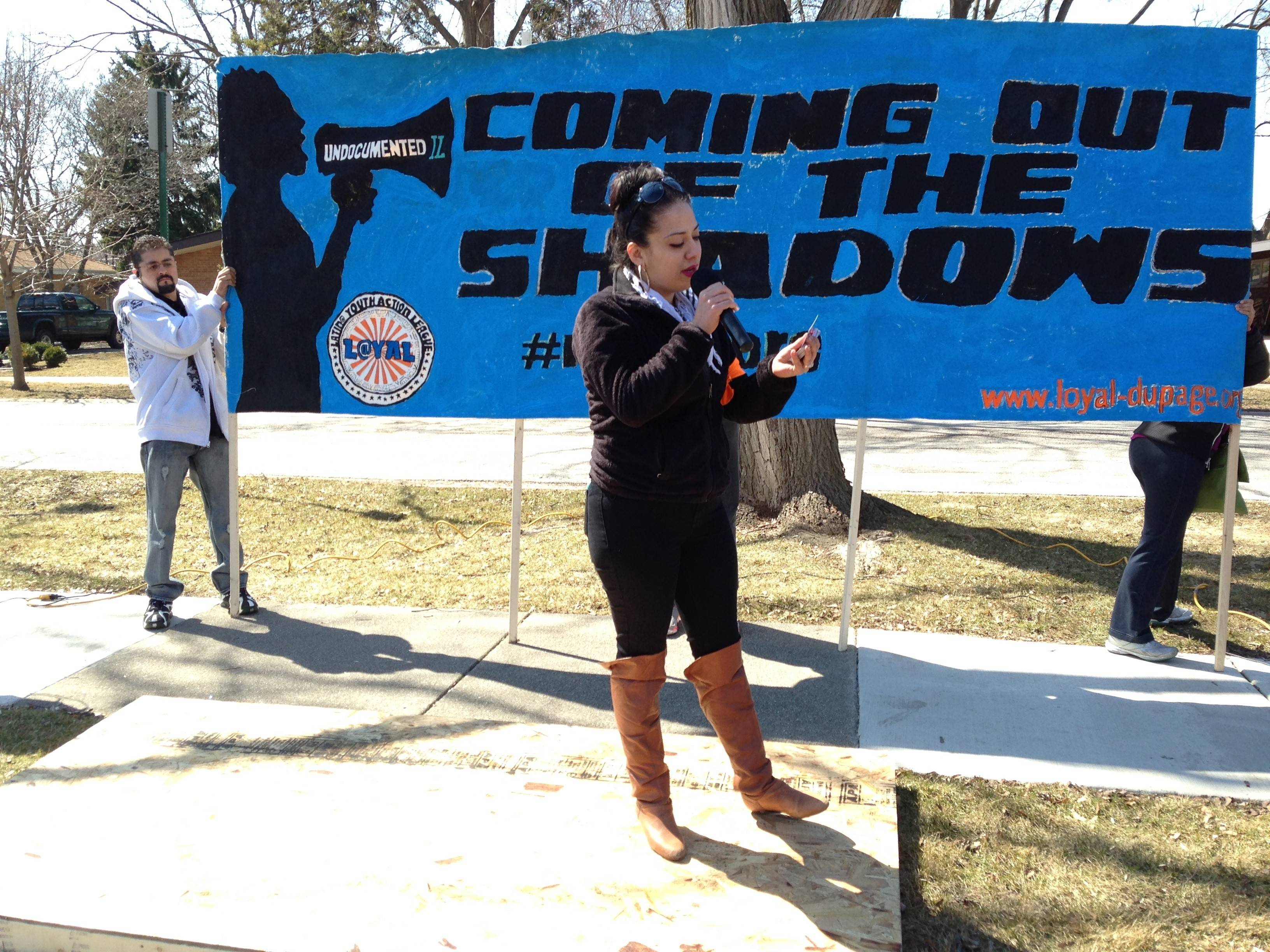 Addison resident Cynthia Brito talks to the crowd Sunday during the Coming Out of the Shadows rally in Bensenville, which called for an end to deportations of undocumented residents.