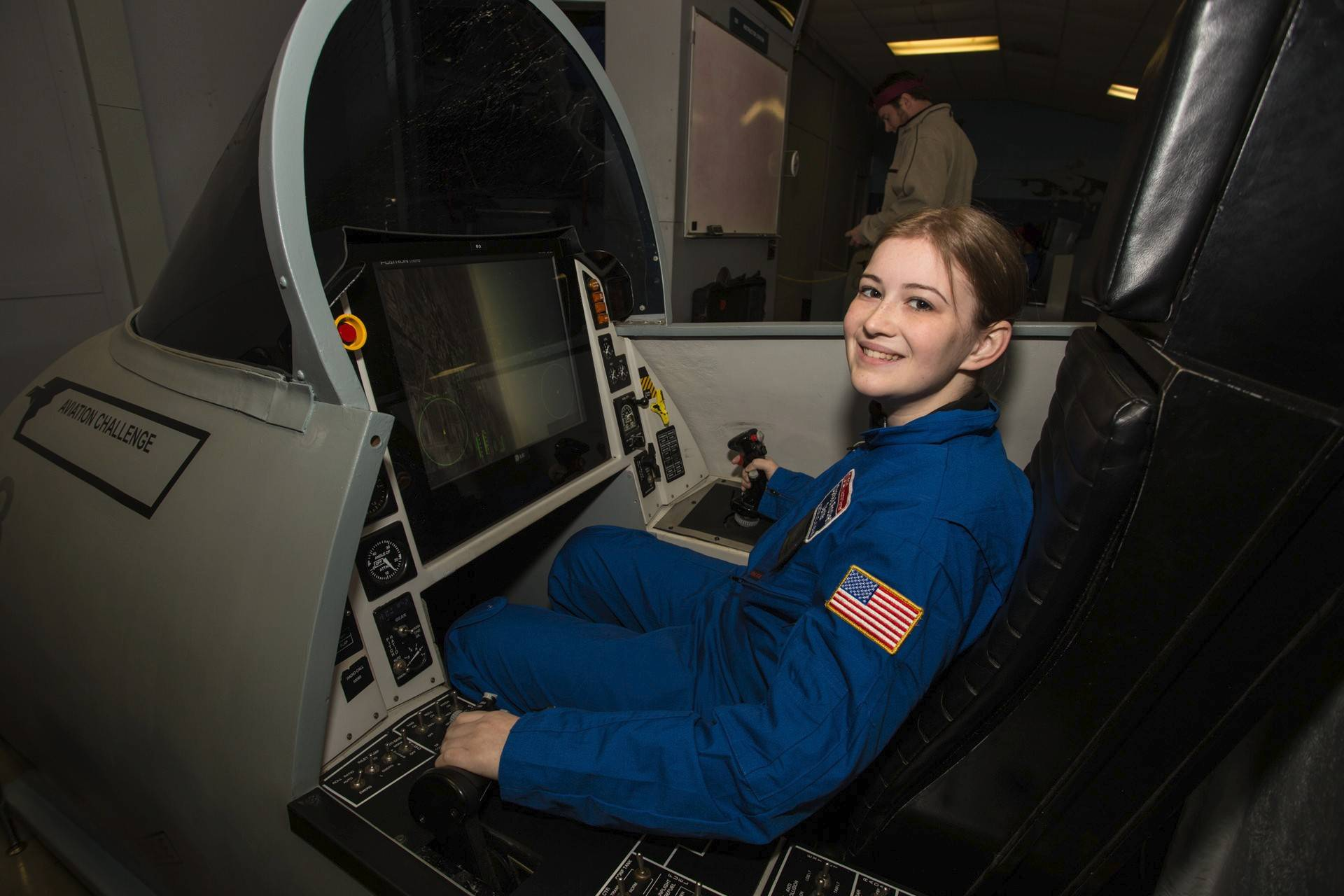 Sabrina Poulsen of Wheeling is at the controls of a space shuttle simulator aviation program that reinforces leadership, teamwork and decision-making while building realistic piloting skills.