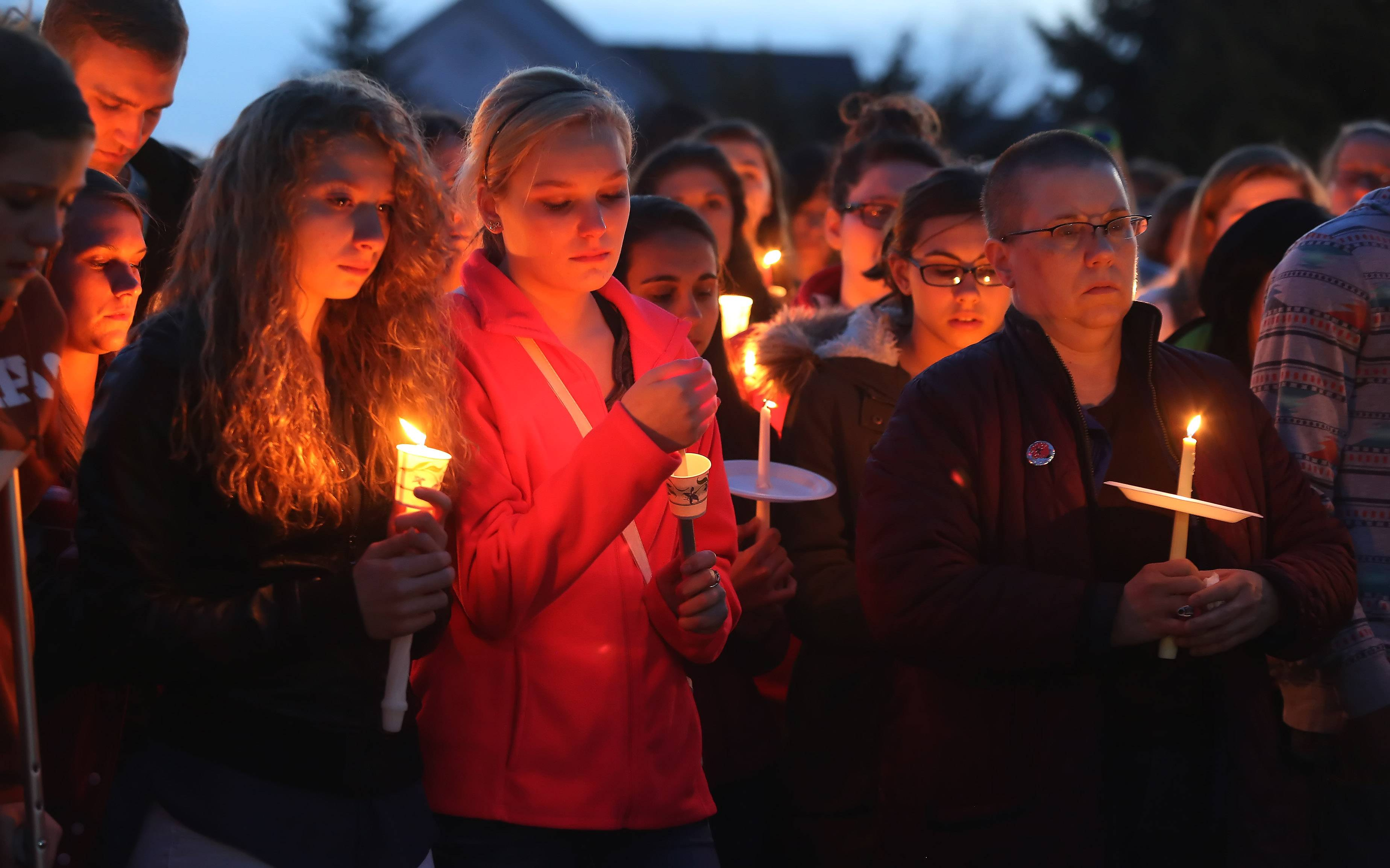 Family and friends attend a candlelight vigil for Jeffrey and Katherine Bronken Sunday night at Heron View Park In Round Lake. The father and daughter were killed in a Florida small plane crash.