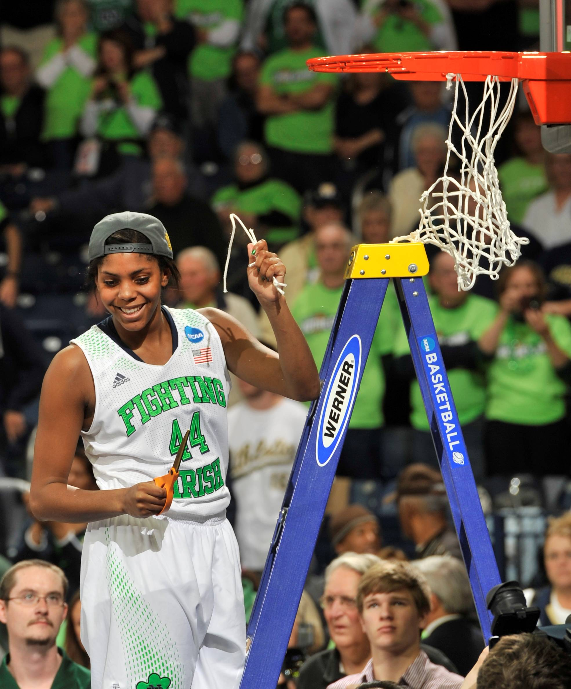 Notre Dame forward Ariel Braker holds a piece of the net Monday after an NCAA women's regional final game at the Purcell Pavilion in South Bend, Ind. Notre Dame beat Baylor 88-69 to advance to the Final Four.