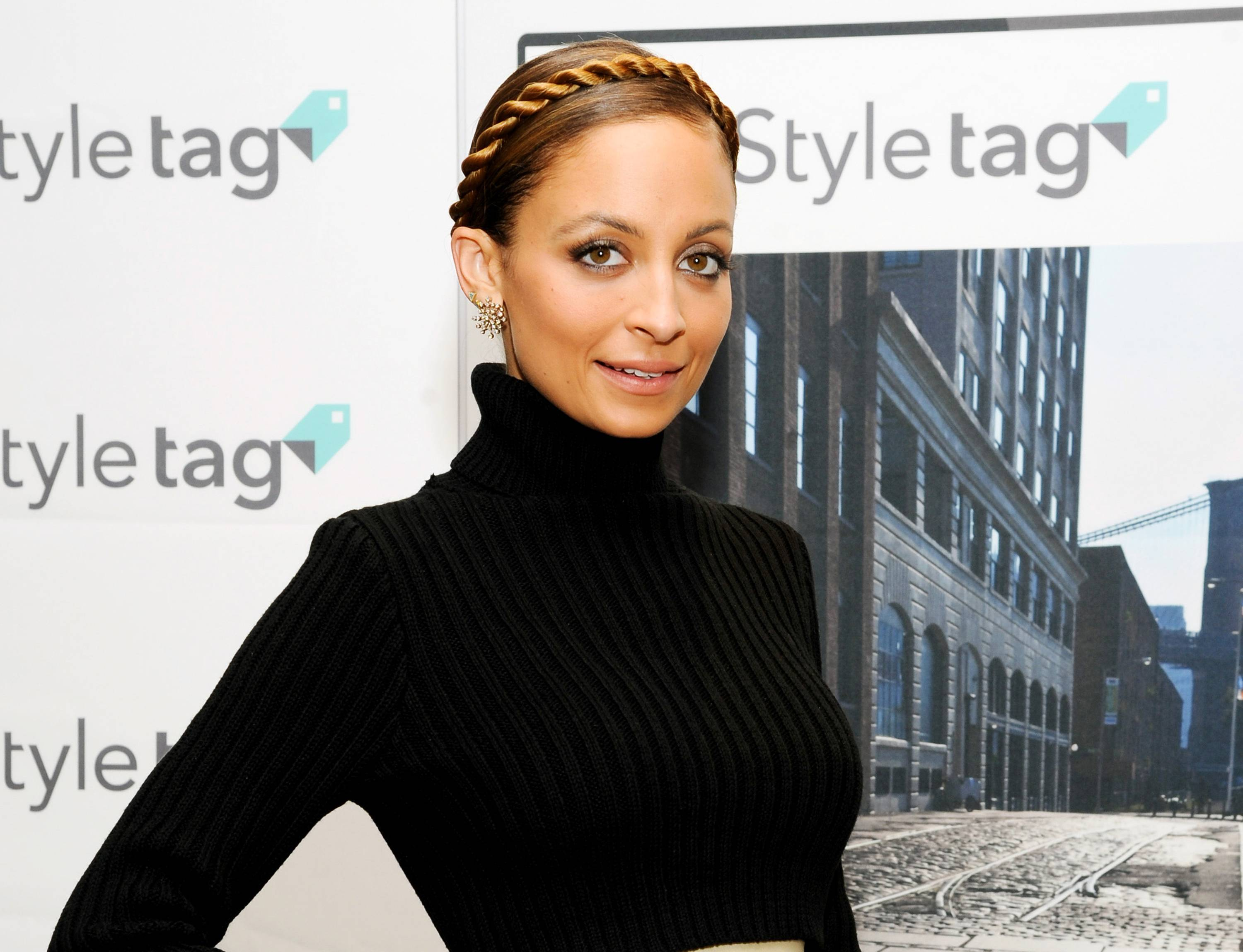 "TV personality and fashion designer Nicole Richie at the launch of SK Planet's Styletag fashion app at Henri Bendel in New York. Richie's ""#CandidlyNicole,"" based on her popular AOL web series, is coming to VH1 and will feature 8 new episodes premiering July 17."