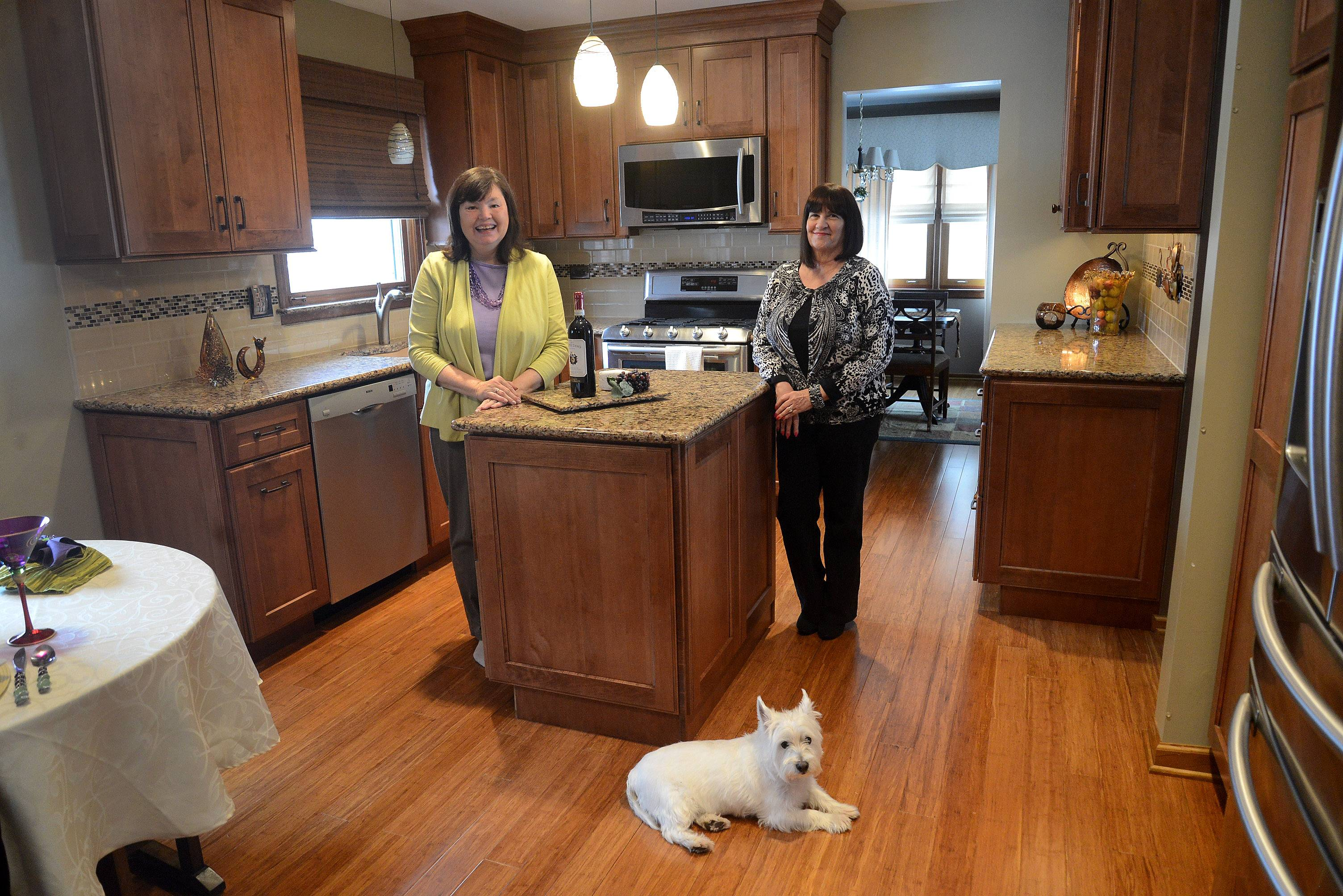 Designer Linda Navara, right, and homeowner Maureen Willenborg in the newly redesigned kitchen in Arlington Heights.