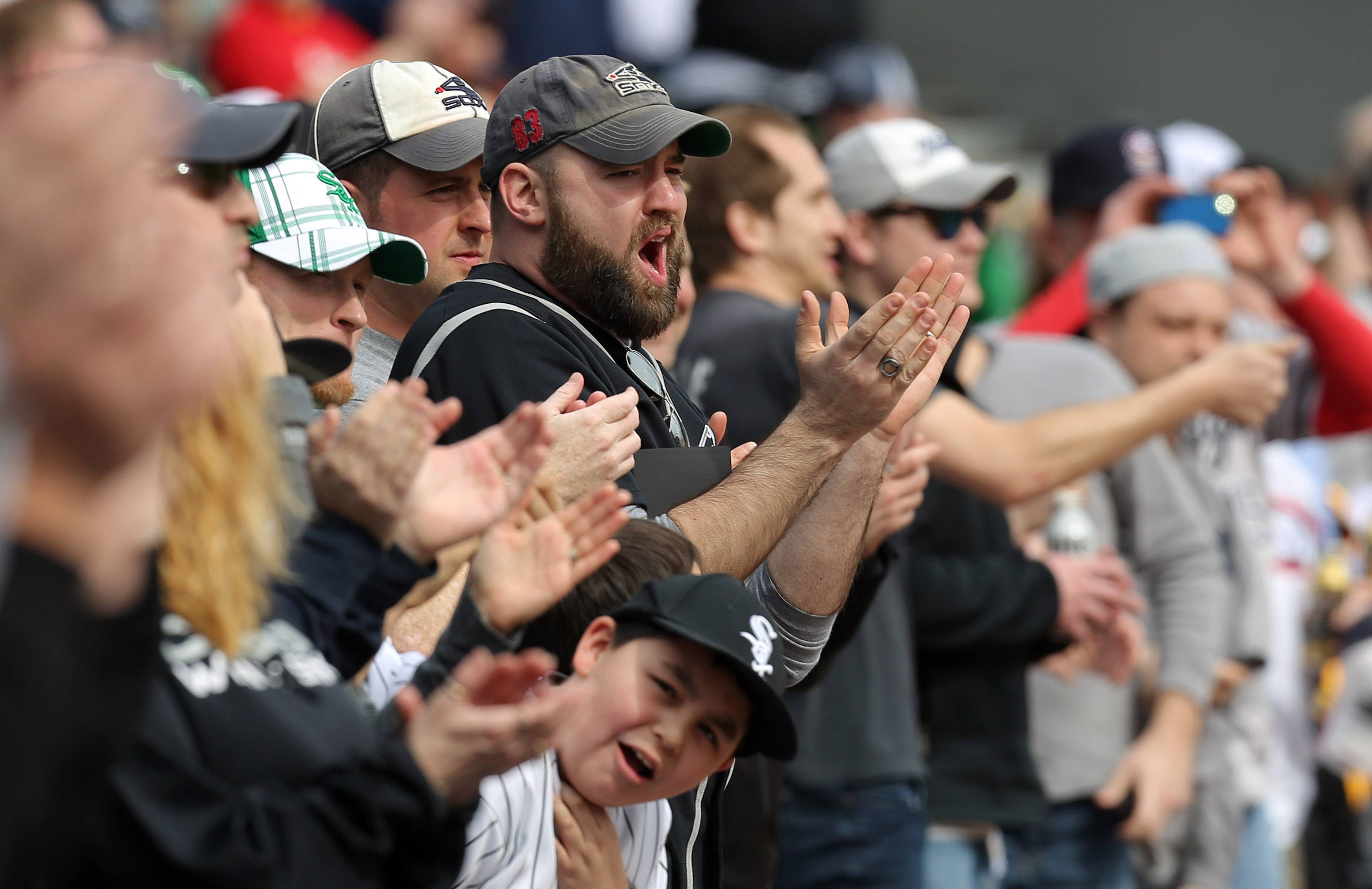 Fans cheer Monday during the White Sox home opener against the Minnesota Twins at U.S. Cellular Field.