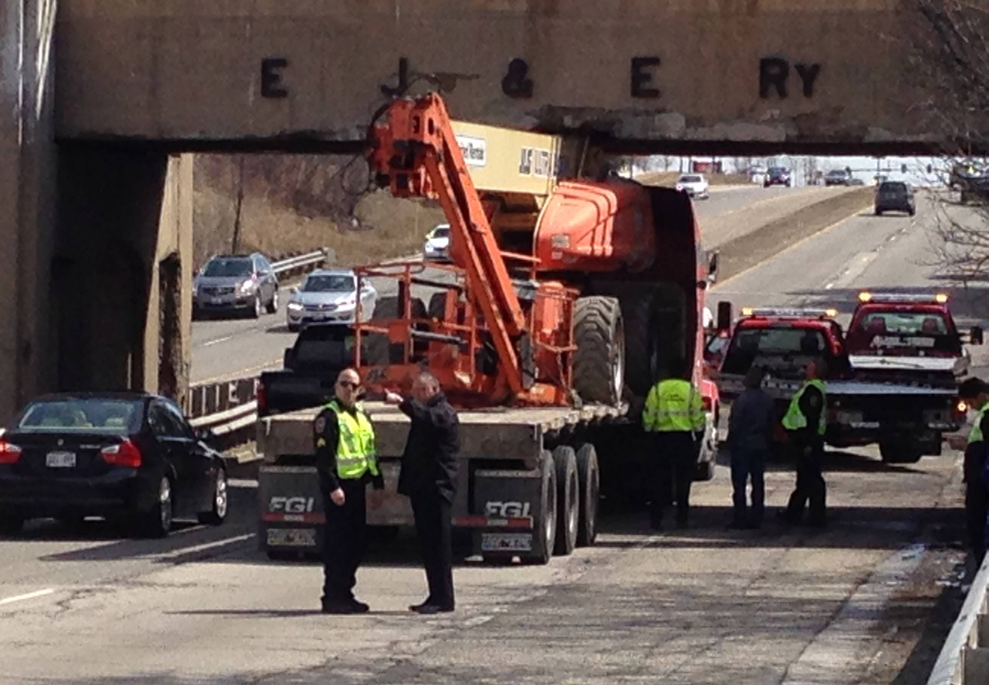 Southbound traffic on Route 12 was slowed Monday morning after a truck carrying a piece of construction equipment got stuck under a railroad bridge near Ela Road in Lake Zurich.