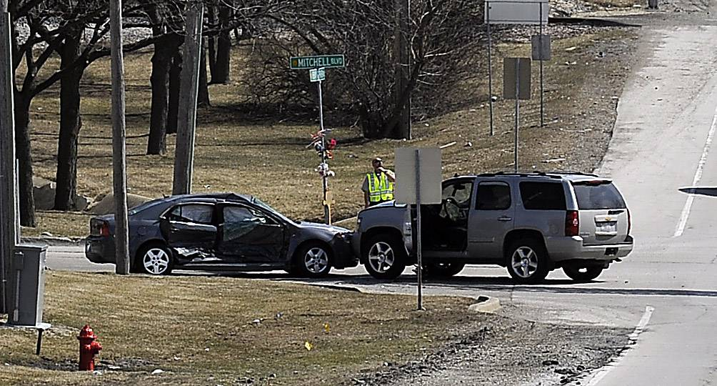 A 77-year-old Schaumburg woman was killed Monday when the car she was riding in collided with an SUV at Irving Park Road and Mitchell Boulevard on the village's south side. Two others were hospitalized after the collision, police said.