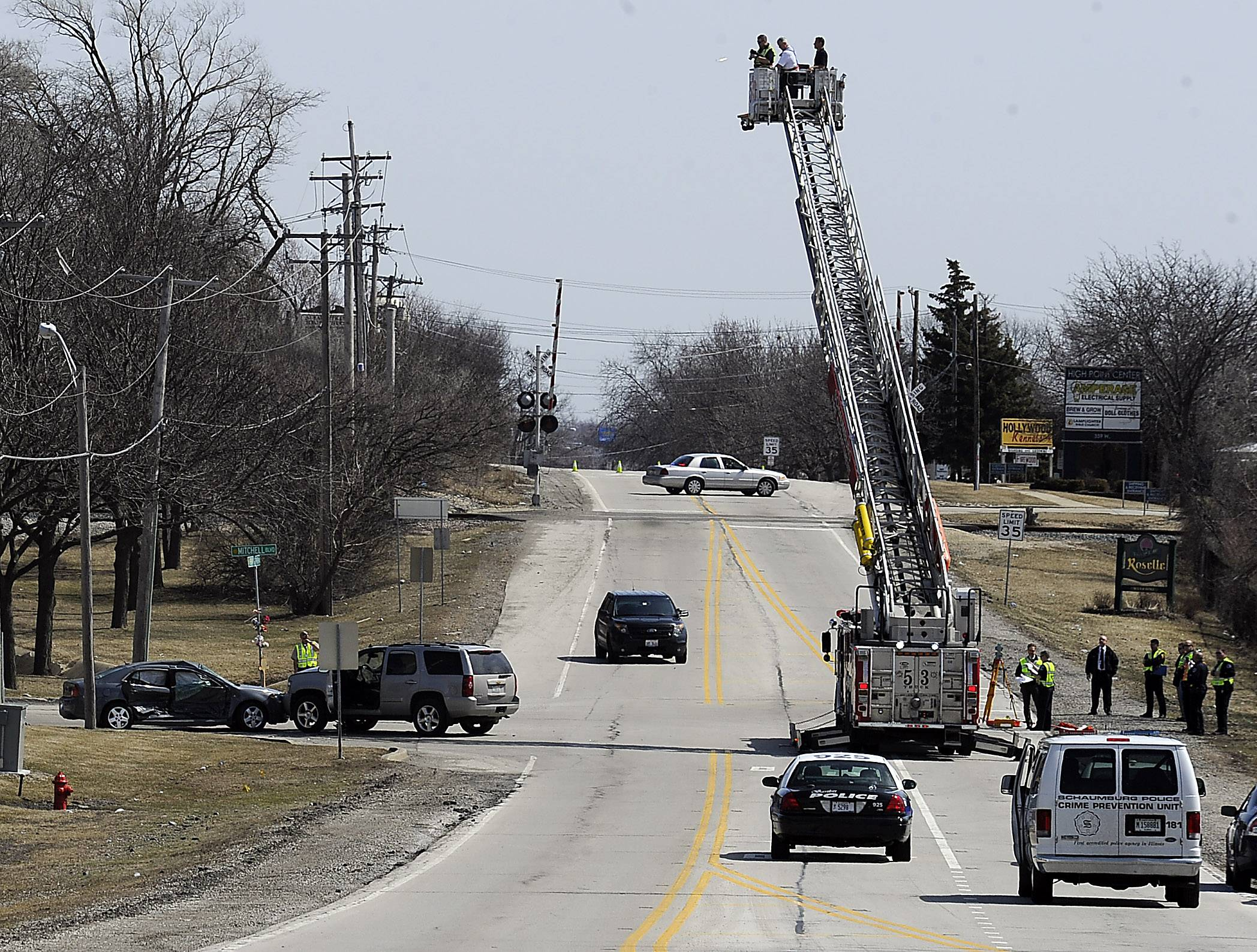 Schaumburg police investigated a two-vehicle crash Monday at Irving Park Road and Mitchell Boulevard that killed a 77-year-old woman and injured two other people. No charges have been filed, police said.