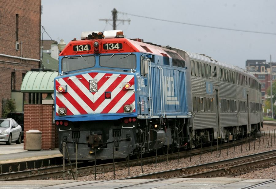 A Metra train leaves the Wheaton train station. A task force appointed by Gov. Pat Quinn would merge Metra, the CTA and Pace and eliminate the Regional Transportation Authority.